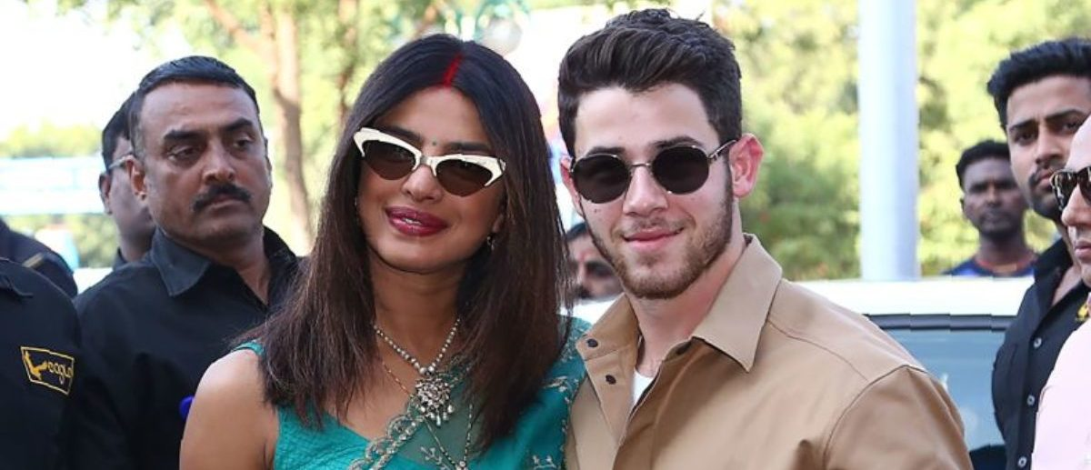 Indian Bollywood actress Priyanka Chopra (C) and US musician Nick Jonas (centre R) pose for a photograph as they leave after their wedding ceremony in Jodhpur in the western Indian state of Rajasthan on December 3, 2018. - Bollywood actress Priyanka Chopra and American singer Nick Jonas hosted an extravagant concert on December 2 for their star-studded wedding guests as the couple tied the knot at a lavish Indian palace. (Photo by - / AFP) (Photo credit should read -/AFP/Getty Images)