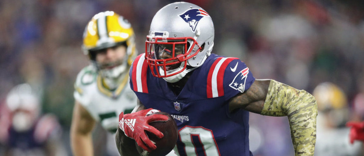 FOXBOROUGH, MA - NOVEMBER 04: Josh Gordon #10 of the New England Patriots runs with the ball on his way to scoring a 55-yard receiving touchdown during the fourth quarter against the Green Bay Packers at Gillette Stadium on November 4, 2018 in Foxborough, Massachusetts. (Photo by Maddie Meyer/Getty Images)