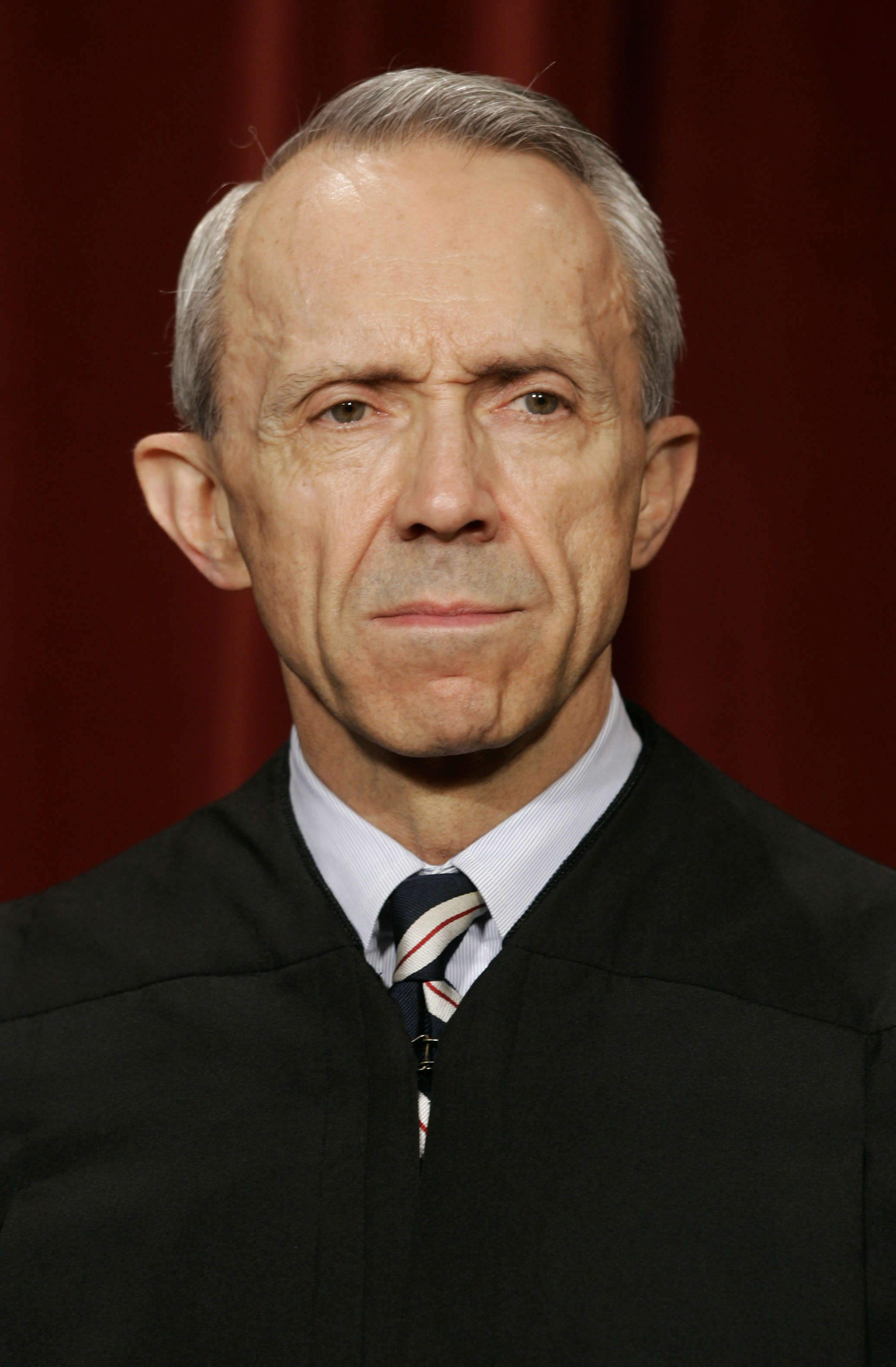Justice David Souter poses for an official picture with other justices at the U.S. Supreme Court in Washington, October 31, 2005.
