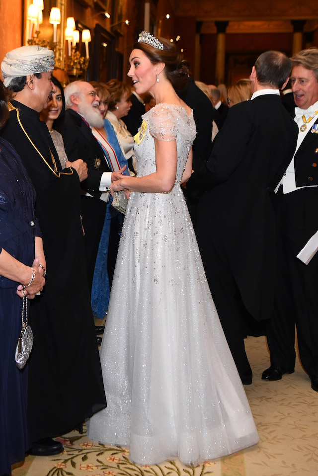 The Duchess of Cambridge talks to guests at an evening reception for members of the Diplomatic Corps at Buckingham Palace in London. PRESS ASSOCIATION Photo. Picture date: Tuesday December 4, 2018. See PA story ROYAL Queen. Photo credit: Victoria Jones/PA Wire