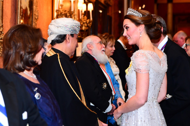 Catherine, Duchess of Cambridge greets guests at an evening reception for members of the Diplomatic Corps at Buckingham Palace on December 04, 2018 in London, England. Approximately 7,500 military personnel are currently serving overseas at Christmas. (Photo by Victoria Jones - WPA Pool/Getty Images)