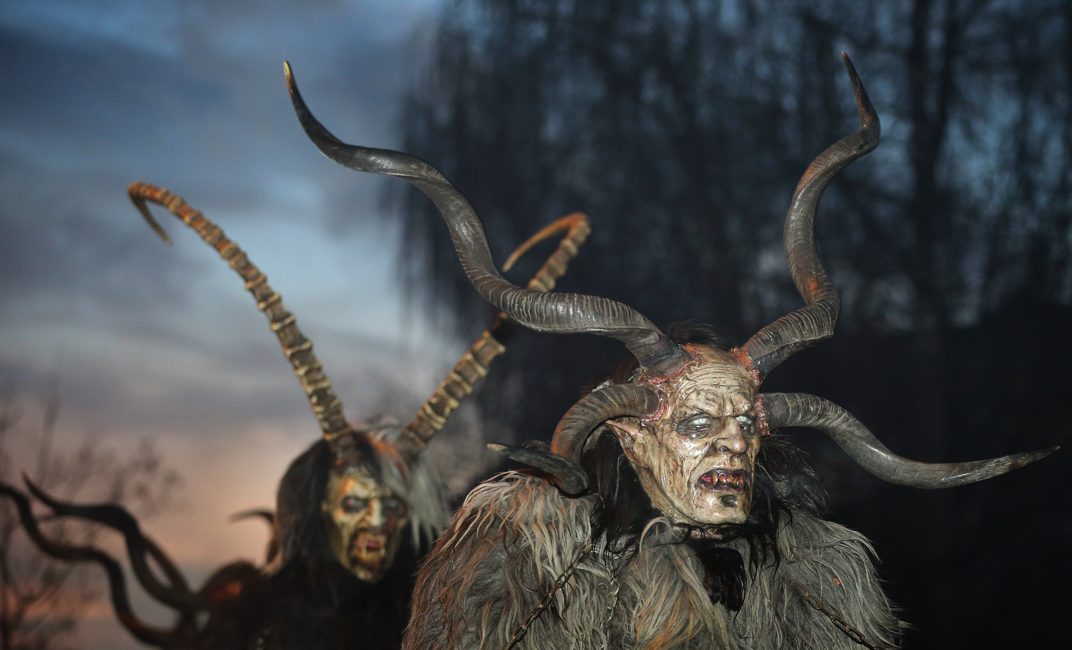 "Men dressed as ""Krampus"", a half-goat, half-demon figure that punishes people who misbehaved during Christmas season, take part in an event in Boerwang, southern Germany, on November 24, 2018. (KARL-JOSEF HILDENBRAND/AFP/Getty Images)"