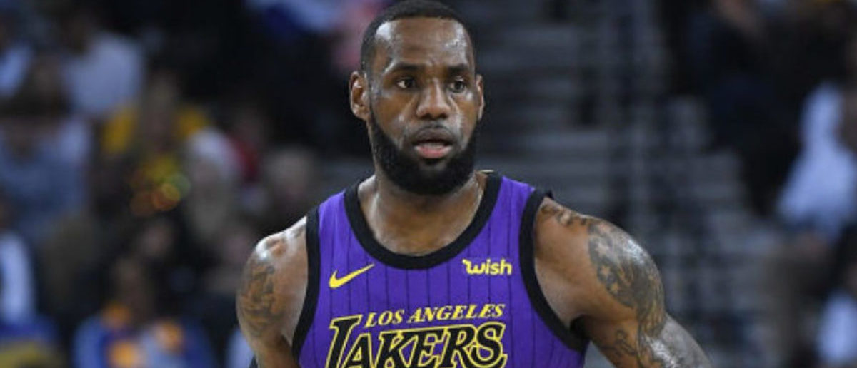 OAKLAND, CA - DECEMBER 25: LeBron James #23 of the Los Angeles Lakers dribbles the ball up court against the Golden State Warriors during the first half of their NBA Basketball game at ORACLE Arena on December 25, 2018 in Oakland, California. (Photo by Thearon W. Henderson/Getty Images)