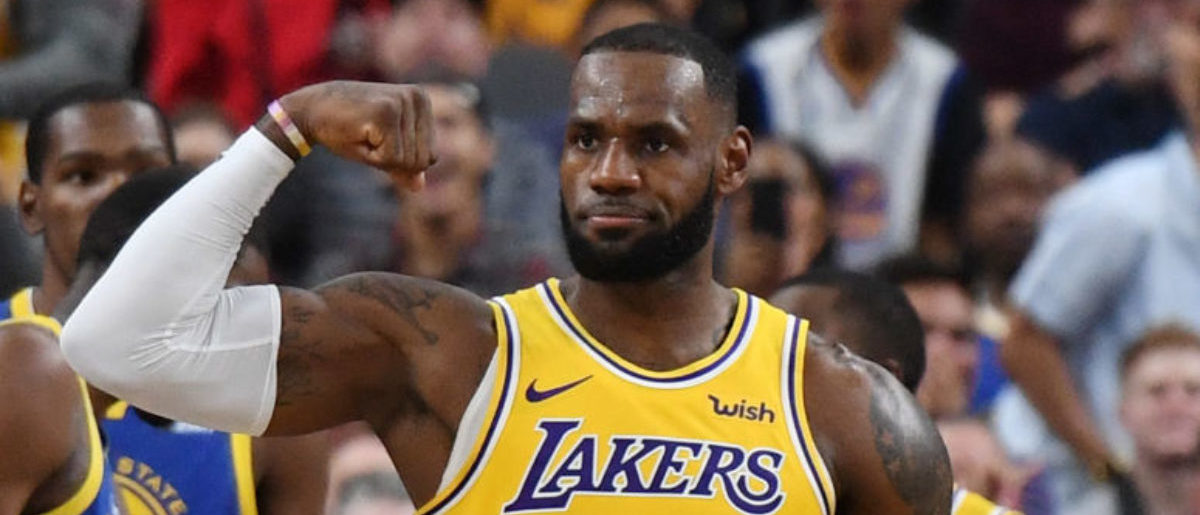 LeBron James #23 of the Los Angeles Lakers celebrates after he made a shot against the Golden State Warriors and was fouled during their preseason game at T-Mobile Arena on October 10, 2018 in Las Vegas, Nevada. The Lakers defeated the Warriors 123-113. (Photo by Ethan Miller/Getty Images)