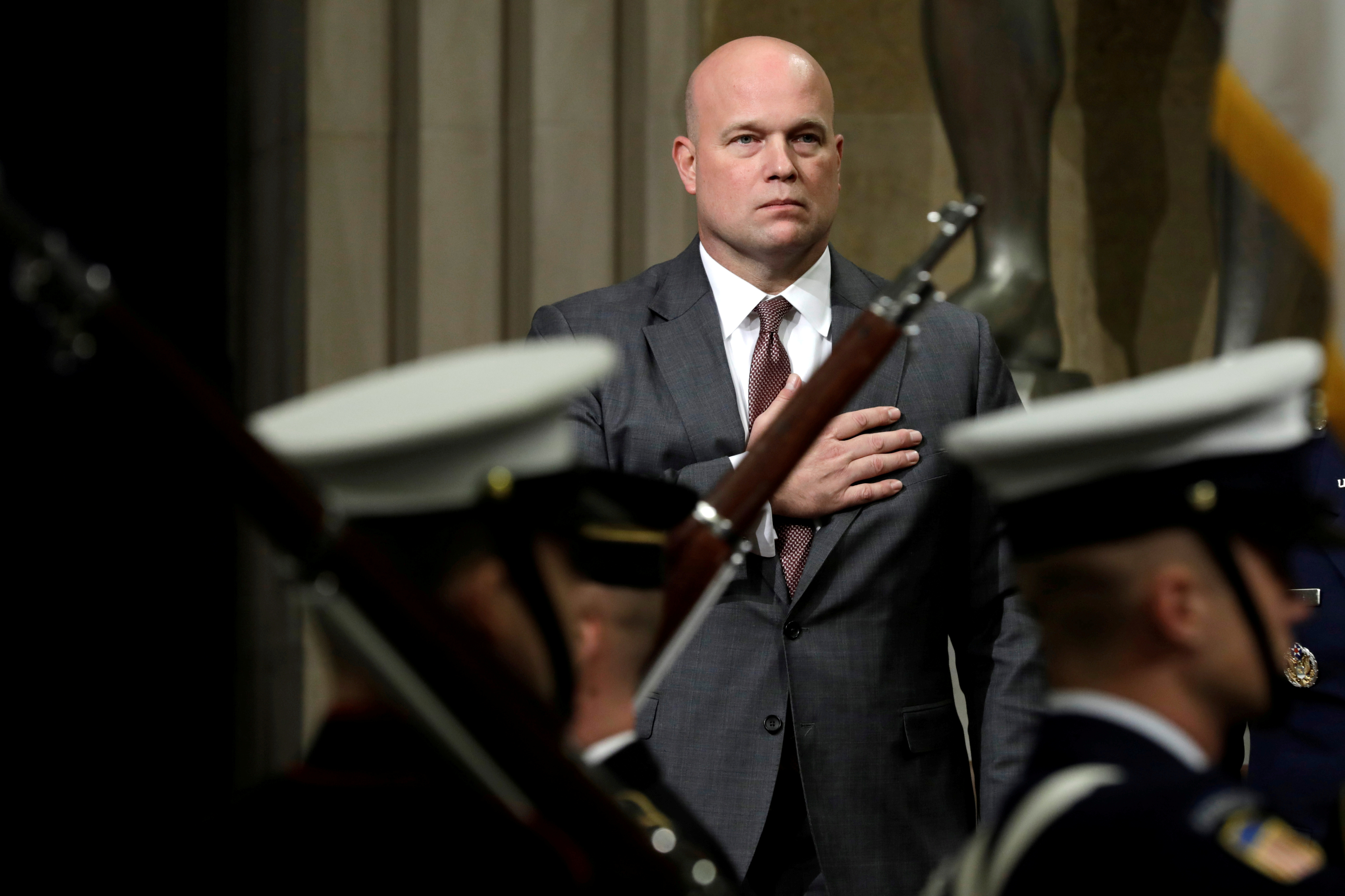 Acting Attorney General Matthew Whitaker stands during a presentation of the colors at the Annual Veterans Appreciation Day Ceremony at the Justice Department in Washington. REUTERS/Yuri Gripas