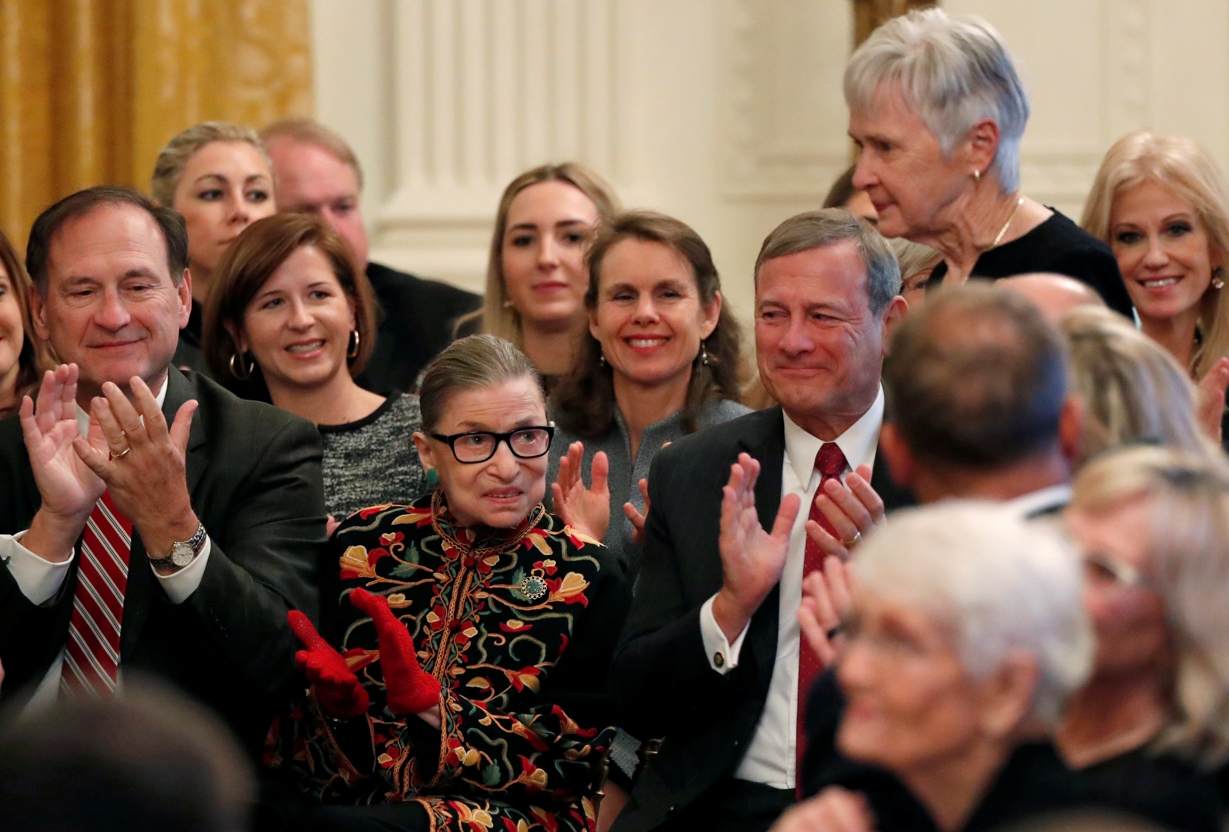 Justice Ruth Bader Ginsburg applauds as Maureen McCarthy Scalia, the wife of late Justice Antonin Scalia, walks to the stage during a ceremony where President Donald Trump awarded the 2018 Presidential Medal of Freedom to Scalia in the White House. REUTERS/Leah Millis