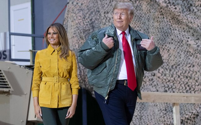 US President Donald Trump and First Lady Melania Trump arrive to speak to members of the US military during an unannounced trip to Al Asad Air Base in Iraq on December 26, 2018. - President Donald Trump arrived in Iraq on his first visit to US troops deployed in a war zone since his election two years ago.(Photo credit: SAUL LOEB/AFP/Getty Images)