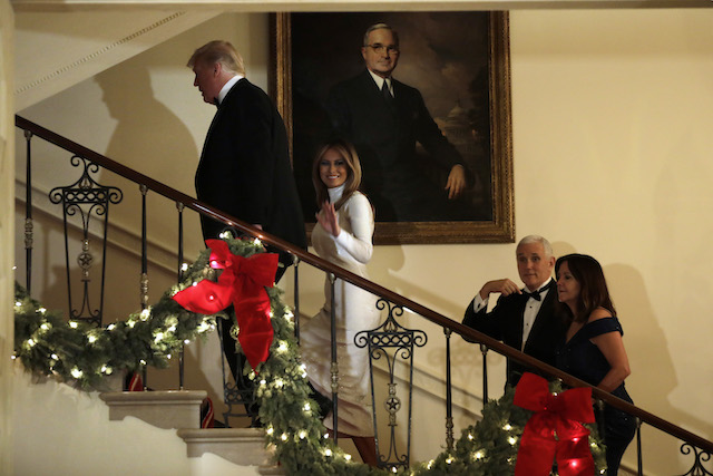 U.S. President Donald Trump with First Lady Melania Trump and Vice President Mike Pence with his wife Karen Pence leave after the Congressional Ball at White House in Washington on December 15, 2018. (Photo by Yuri Gripas-Pool/Getty Images)