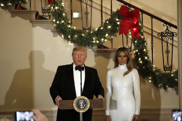 U.S. President Donald Trump speaks next to First Lady Melania Trump at the Congressional Ball at White House in Washington on December 15, 2018. (Photo by Yuri Gripas-Pool/Getty Images)