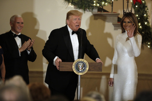 U.S. President Donald Trump speaks between First Lady Melania Trump and Vice President Mike Pence at the Congressional Ball at White House in Washington on December 15, 2018. (Photo by Yuri Gripas-Pool/Getty Images)