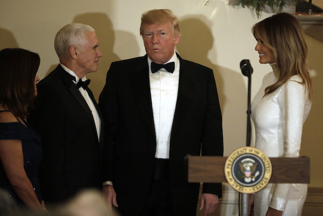 U.S. President Donald Trump with First Lady Melania Trump (R), Vice President Mike Pence and his wife Karen Pence attend the Congressional Ball at White House in Washington on December 15, 2018. (Photo by Yuri Gripas-Pool/Getty Images)