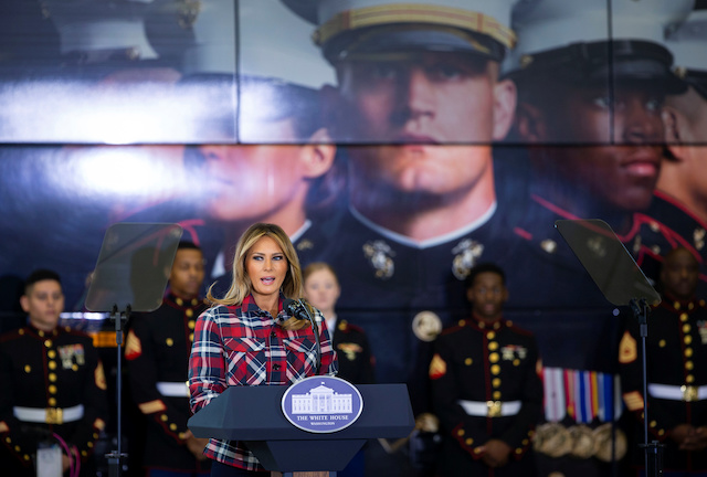 U.S. first lady Melania Trump speaks before helping to sort and box toys for the Marine Corps Reserve Toys for Tots campaign at Joint Base Anacostia-Bolling in Washington, U.S., December 11, 2018. REUTERS/Al Drago