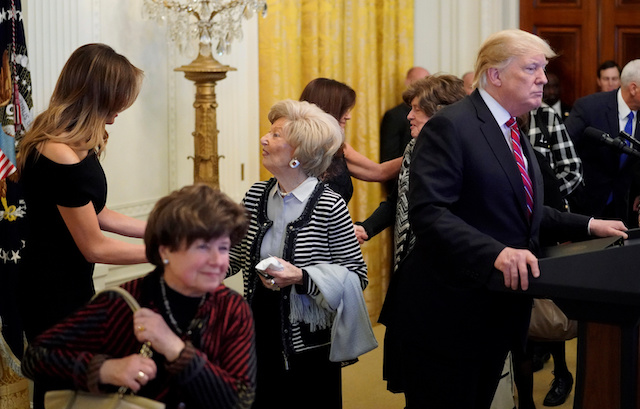 U.S. First lady Melania Trump greets guests as she appears with President Donald Trump at a Hanukkah reception in the East Room of the White House in Washington, U.S. December 6, 2018. REUTERS/Jonathan Ernst
