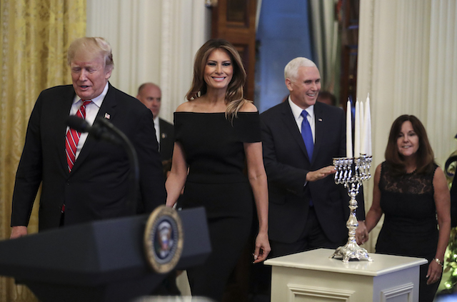 President Donald Trump, first lady Melania Trump, Vice President Mike Pence and his wife Karen Pence attend a Hanukkah reception in the East Room of the White House on December 6, 2018 in Washington, DC. (Photo by Oliver Contreras-Pool/Getty Images)