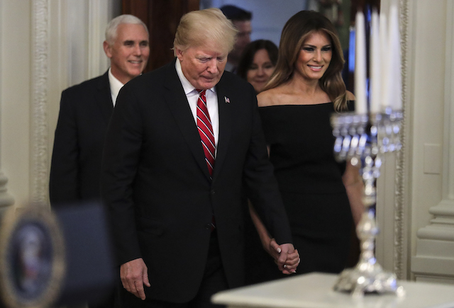 President Donald Trump and first lady Melania Trump attend a Hanukkah reception in the East Room of the White House on December 6, 2018 in Washington, DC. (Photo by Oliver Contreras-Pool/Getty Images)