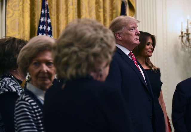 US President Donald Trump and First Lady Melania Trump attend a Hanukkah reception with Holocaust survivors in the East Room of the White House on December 6, 2018 in Washington,DC. (Photo credit: BRENDAN SMIALOWSKI/AFP/Getty Images)