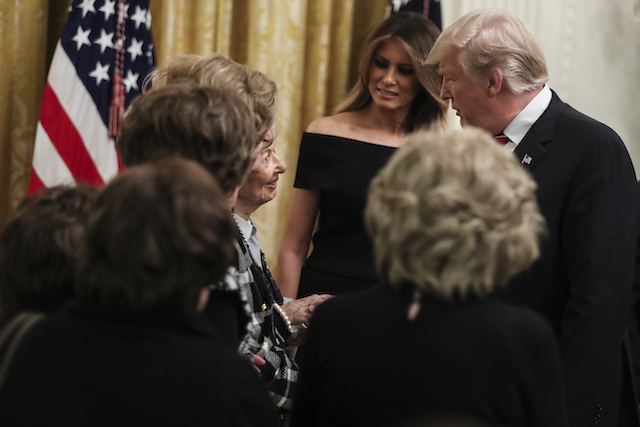 President Donald Trump and first lady Melania Trump greet holocaust survivors during a Hanukkah reception in the East Room of the White House on December 6, 2018 in Washington, DC. (Photo by Oliver Contreras-Pool/Getty Images)