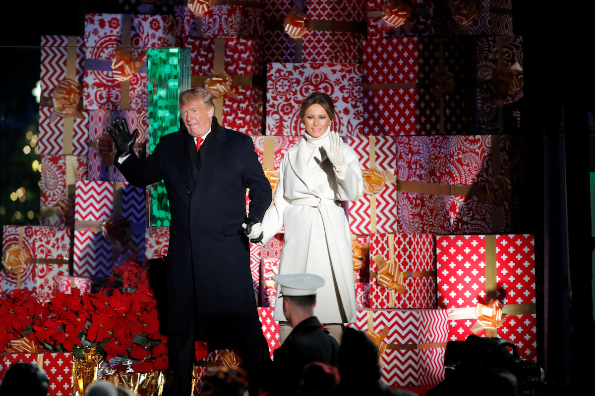 U.S. President Donald Trump and first lady Melania Trump arrive for the 96th annual National Christmas Tree Lighting ceremony near the White House in Washington, U.S., November 28, 2018. REUTERS/Jim Young