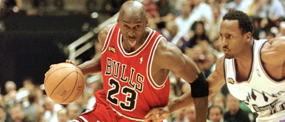 SALT LAKE CITY, UNITED STATES: Michael Jordan (L) of the Chicago Bulls goes to the basket past Shandon Anderson of the Utah Jazz 14 June during game six of the NBA Finals at the Delta Center in Salt Lake City, UT. The Bulls lead the best-of-seven series 3-2. (Photo credit: MIKE NELSON/AFP/Getty Images)