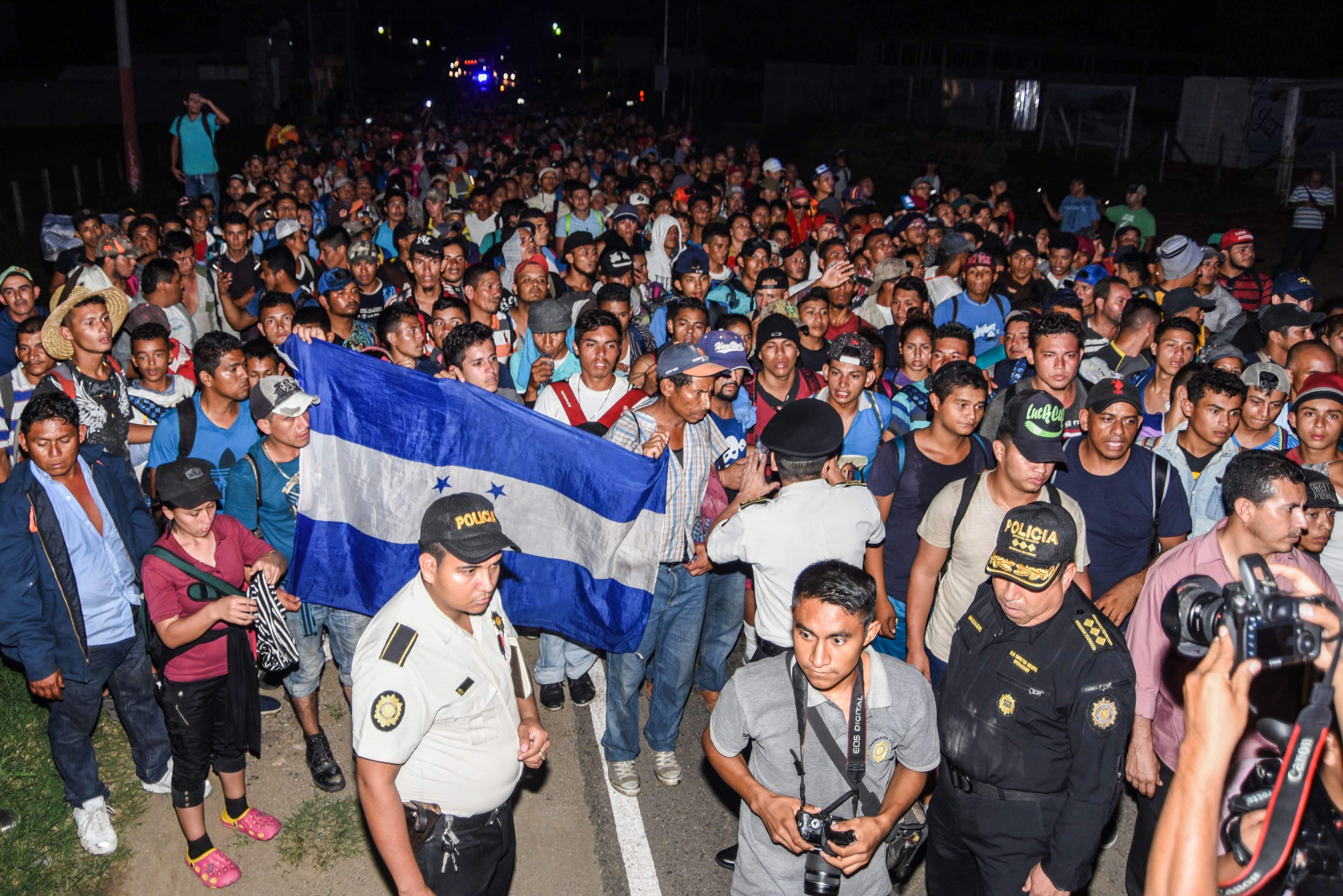 TOPSHOT - Honduran migrants taking part in a new caravan heading to the US, arrive to Chiquimula, Guatemala, on October 22, 2018. - US President Donald Trump on Monday called the migrant caravan heading toward the US-Mexico border a national emergency, saying he has alerted the US border patrol and military. (ORLANDO ESTRADA/AFP/Getty Images)