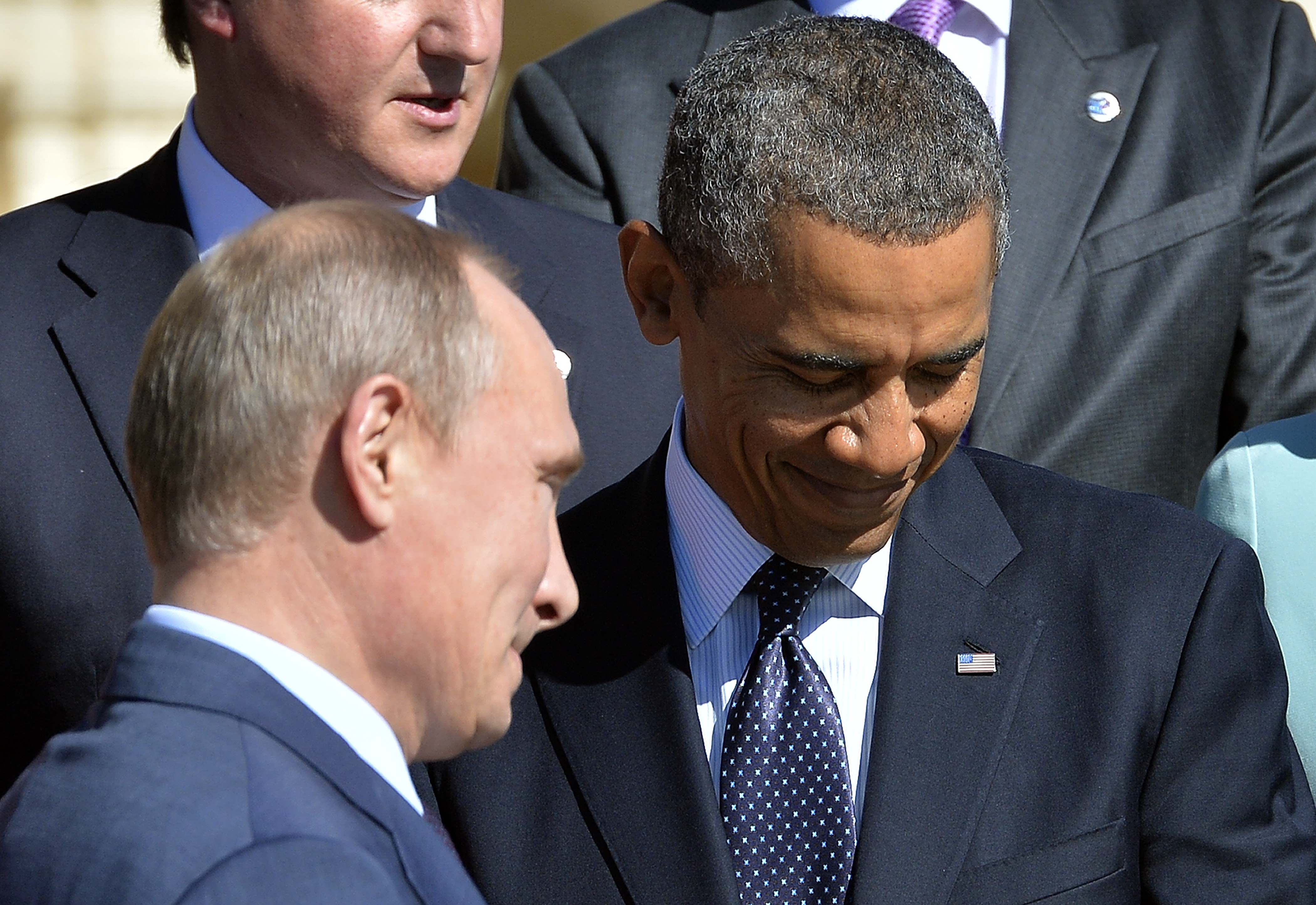 Russias President Vladimir Putin (L) walks past US President Barack Obama as he arrives to pose for the family photo during the G20 summit on September 6, 2013 in Saint Petersburg. World leaders at the G20 summit on Friday failed to bridge their bitter divisions over US plans for military action against the Syrian regime, with Washington signalling that it has given up on securing Russia's support at the UN on the crisis. AFP PHOTO / JEWEL SAMAD (Photo credit should read JEWEL SAMAD/AFP/Getty Images)