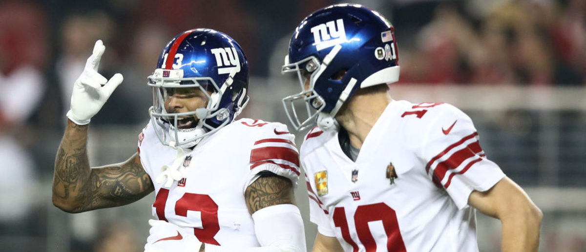 SANTA CLARA, CA - NOVEMBER 12: Odell Beckham #13 of the New York Giants celebrates with Eli Manning #10 after scoring a 20-yard touchdown against the San Francisco 49ers during their NFL game at Levi's Stadium on November 12, 2018 in Santa Clara, California. (Photo by Ezra Shaw/Getty Images)