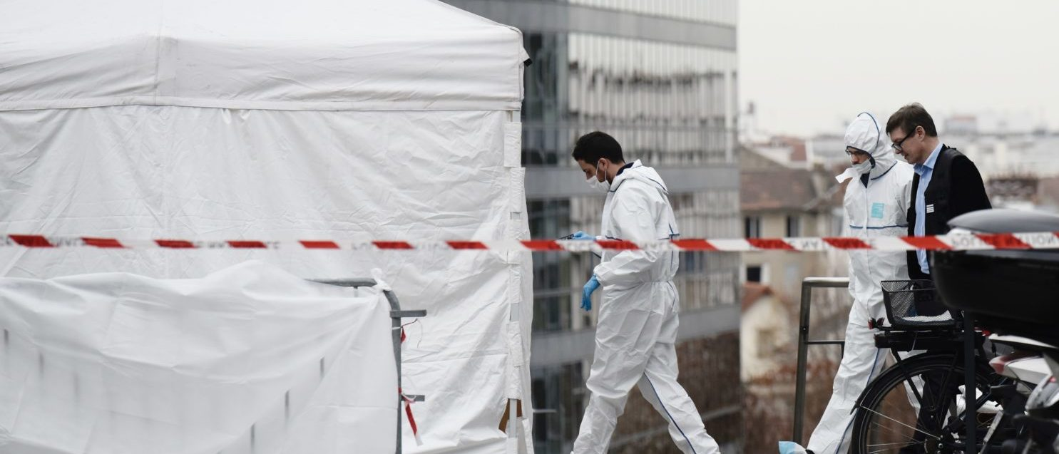 Forensic police worker on Dec. 5, 2018 in front of the main entrance of the private Leonard-de-Vinci university in Courbevoie, northwest of Paris, where a 66-year-old teacher was repeatedly stabbed to death and a Pakistani suspect arrested. (PHILIPPE LOPEZ/AFP/Getty Images)