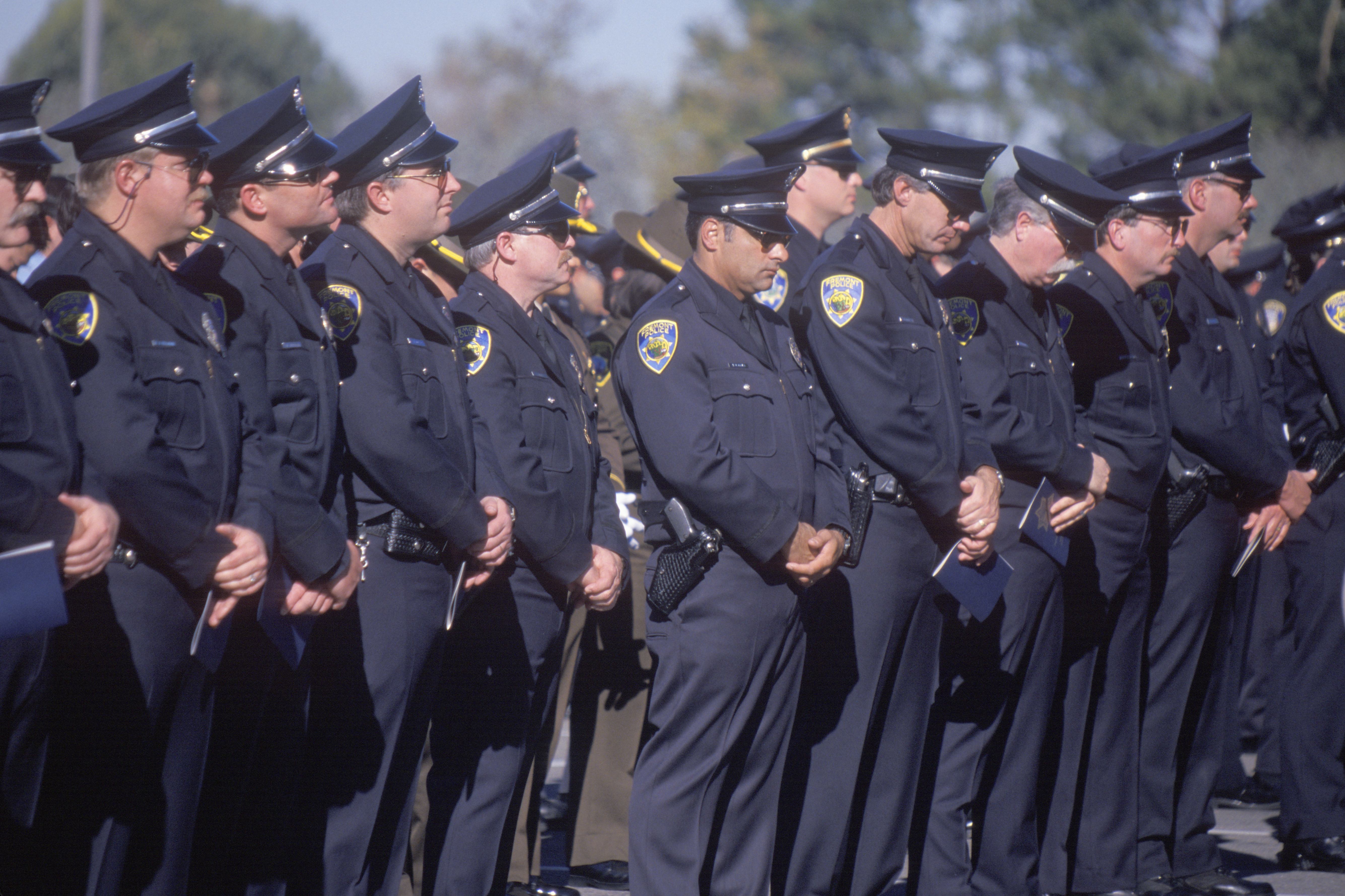 Pictured are police officers. SHUTTERSTOCK/ Joseph Sohm