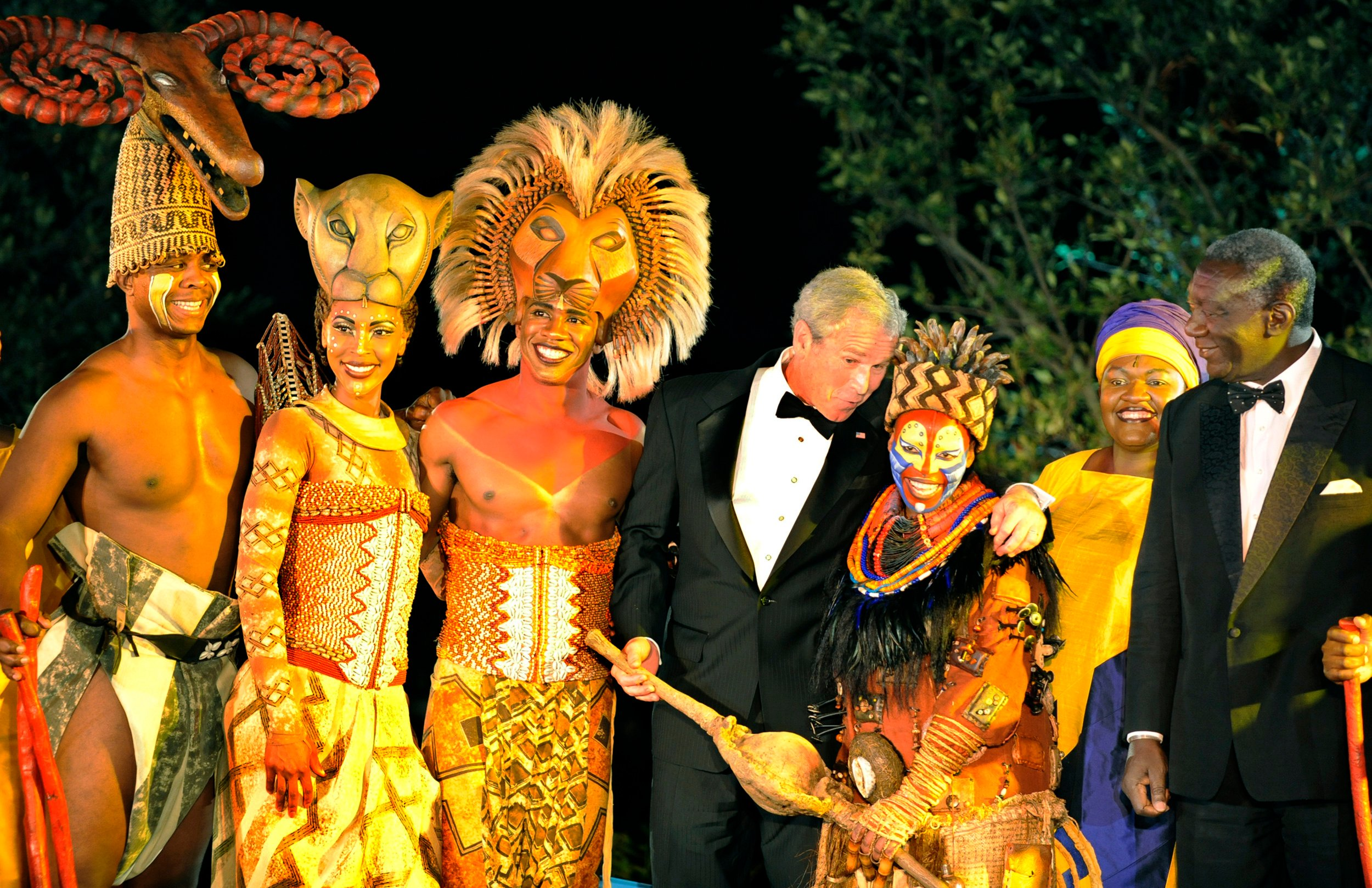 "U.S. President George W. Bush (C) joins characters from the Disney Broadway production of ""The Lion King"" on stage with Ghana's President John Kufuor (R) at the conclusion of a State Dinner at the White House in Washington September 15, 2008. REUTERS/Mike Theiler"