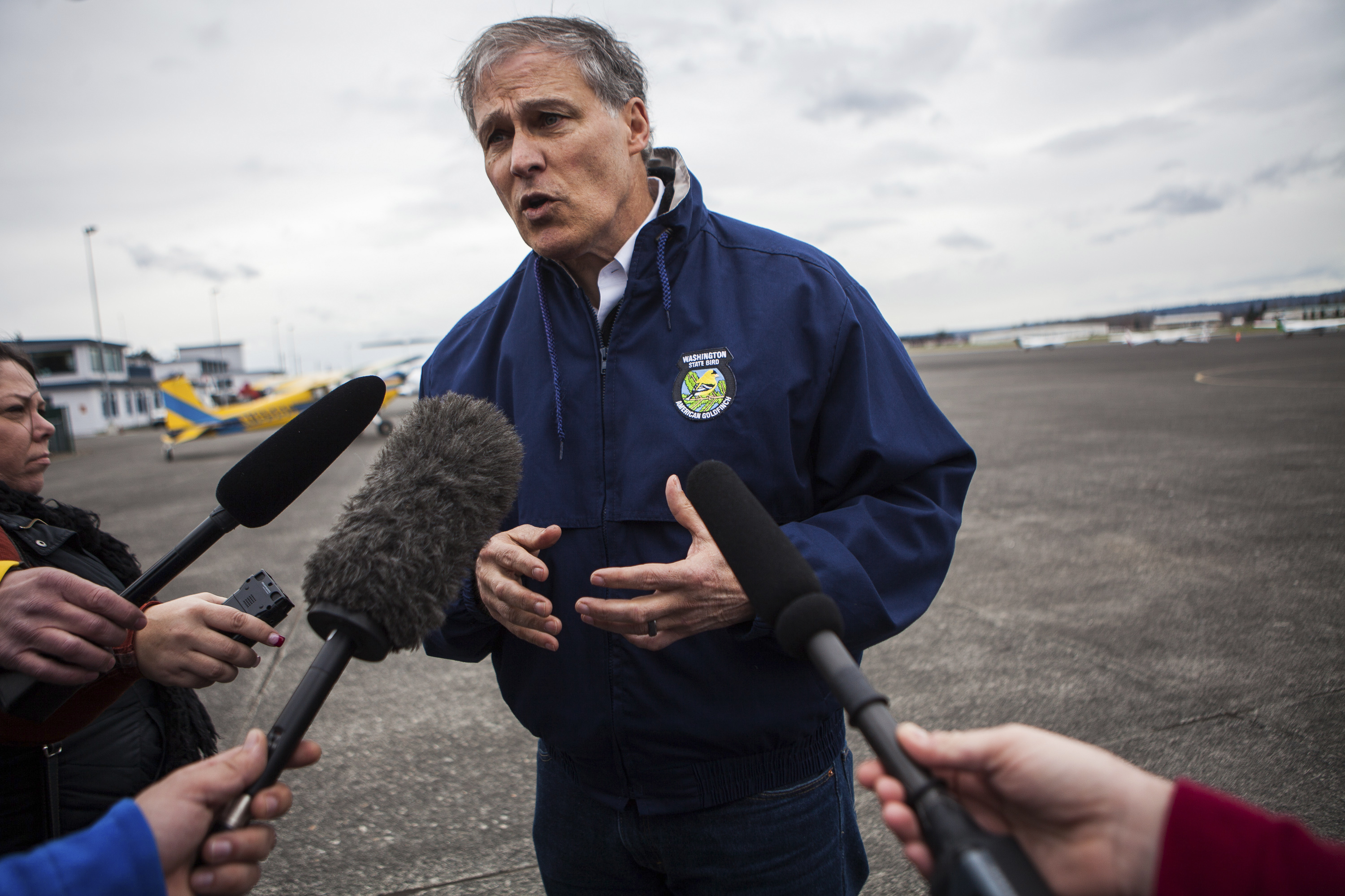 Washington Governor Inslee talks to reporters about ongoing recovery operations for the Oso mudslide, at the Arlington Municipal Airport in Arlington