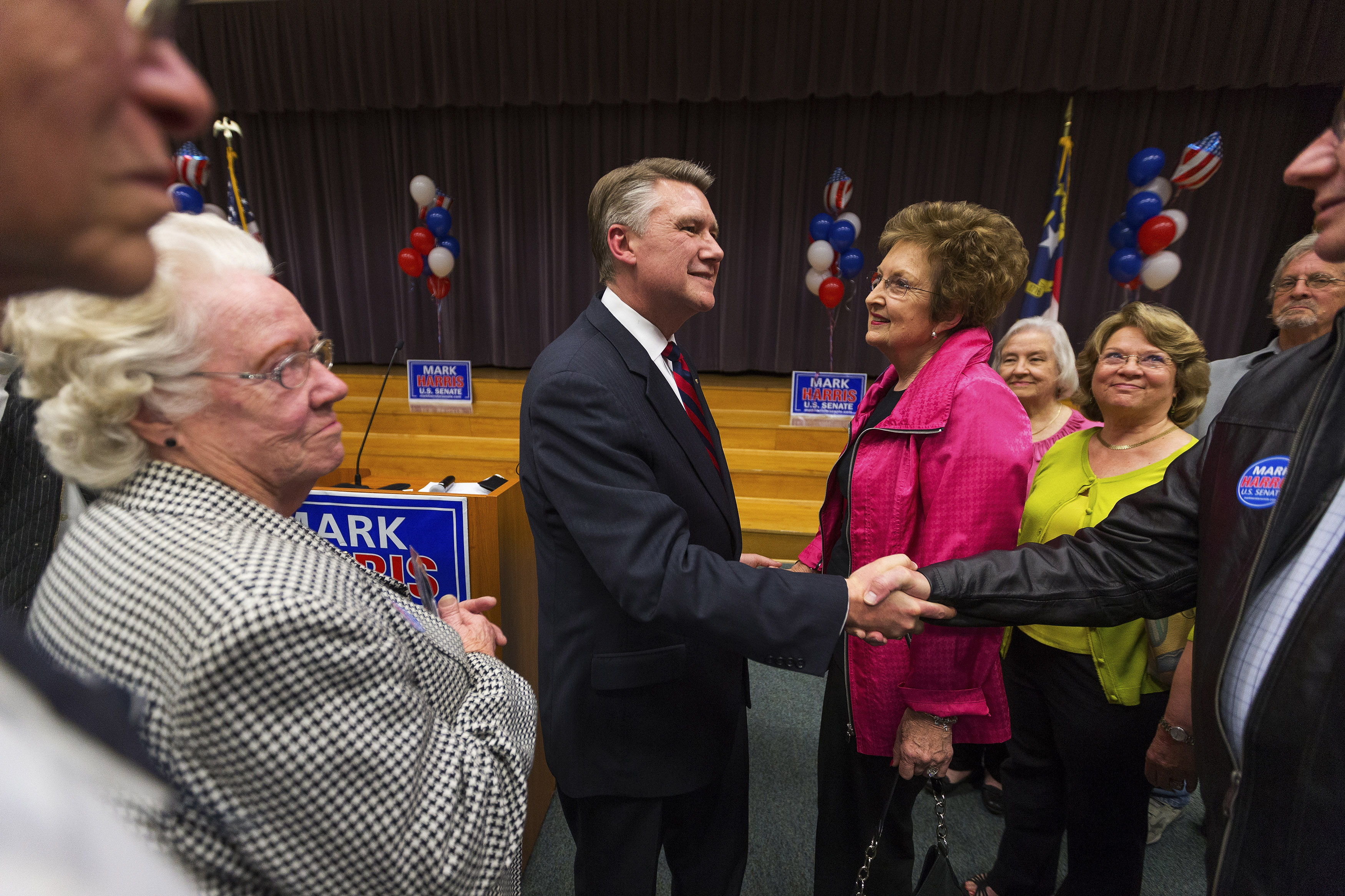 Republican candidate for the U.S. Senate Mark Harris shakes hands with a supporter after a volunteer meeting and rally at the Ardmore Auditorium in Winston-Salem, North Carolina April 8, 2014. REUTERS/Chris Keane