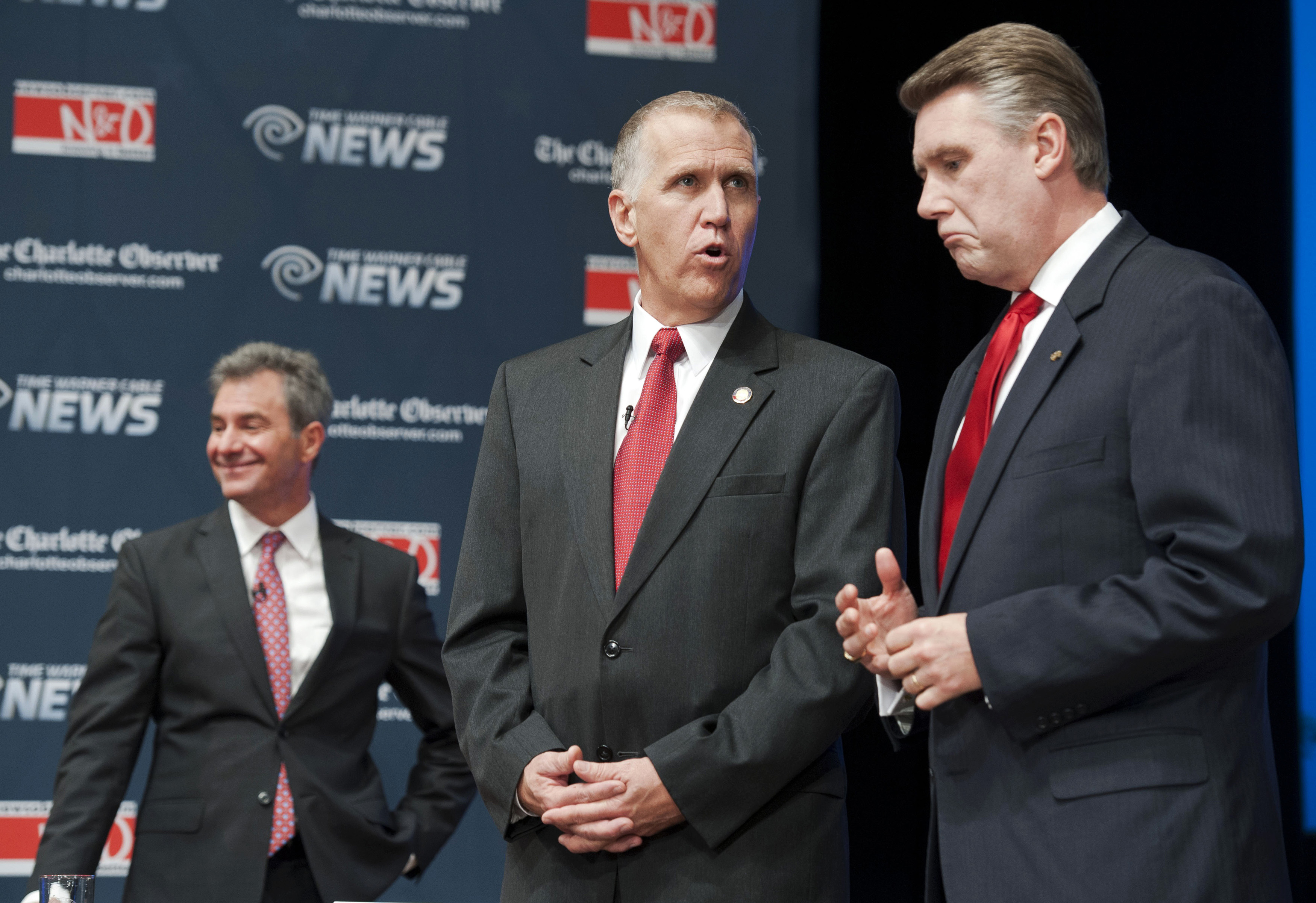 Thom Tillis (C) talks with Mark Harris, (R) before a debate between the four top-polling Republican candidates in North Carolina for the U.S. Senate, at Davidson College in Davidson, North Carolina April 22, 2014. Also shown is candidate Greg Brannon (L). Picture taken April 22, 2014. NORTH CAROLINA-SENATE REUTERS/Davis Turner