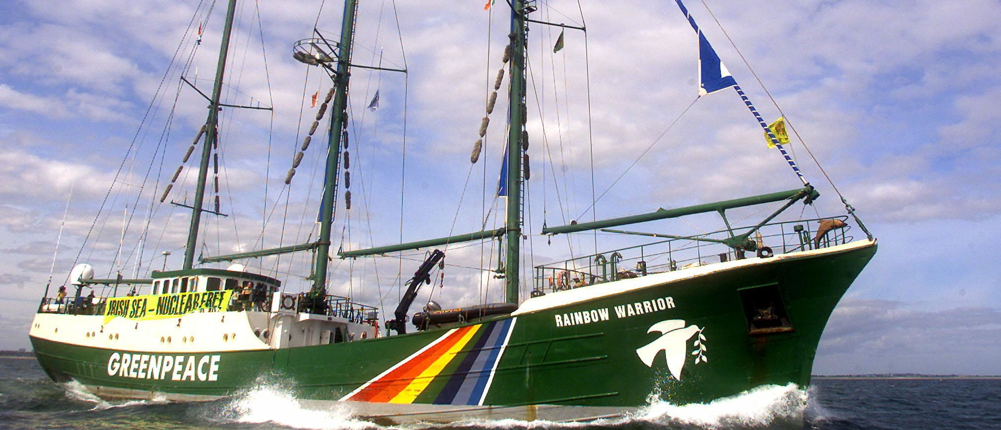 The Greenpeace ship Rainbow Warrior leads a peaceful protest against a cargo of rejected plutonium fuel currently on route from Japan to Sellafield in the north of Britain, in Dublin Bay, Republic of Ireland September 1, 2002. The plutonium ships, Pacific Pintail and the Pacific Teal, are currently mid-south Atlantic and are expected to enter European waters in the first week of September. REUTERS/Paul McErlane.
