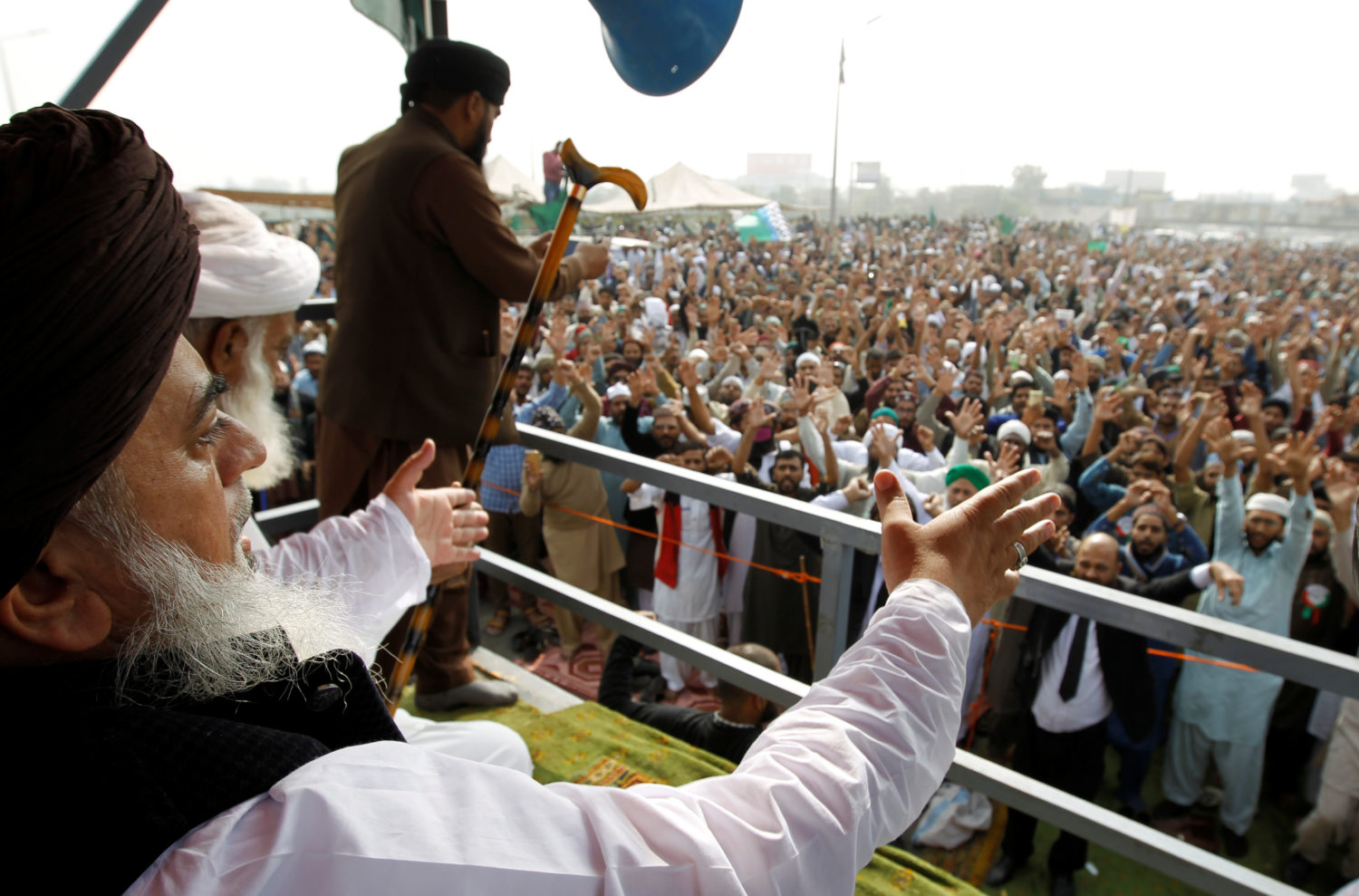 Khadim Hussain Rizvi, leader of the Tehreek-e-Labaik Pakistan far right Islamist political party, leads members in shouting slogans during a sit-in in Rawalpindi