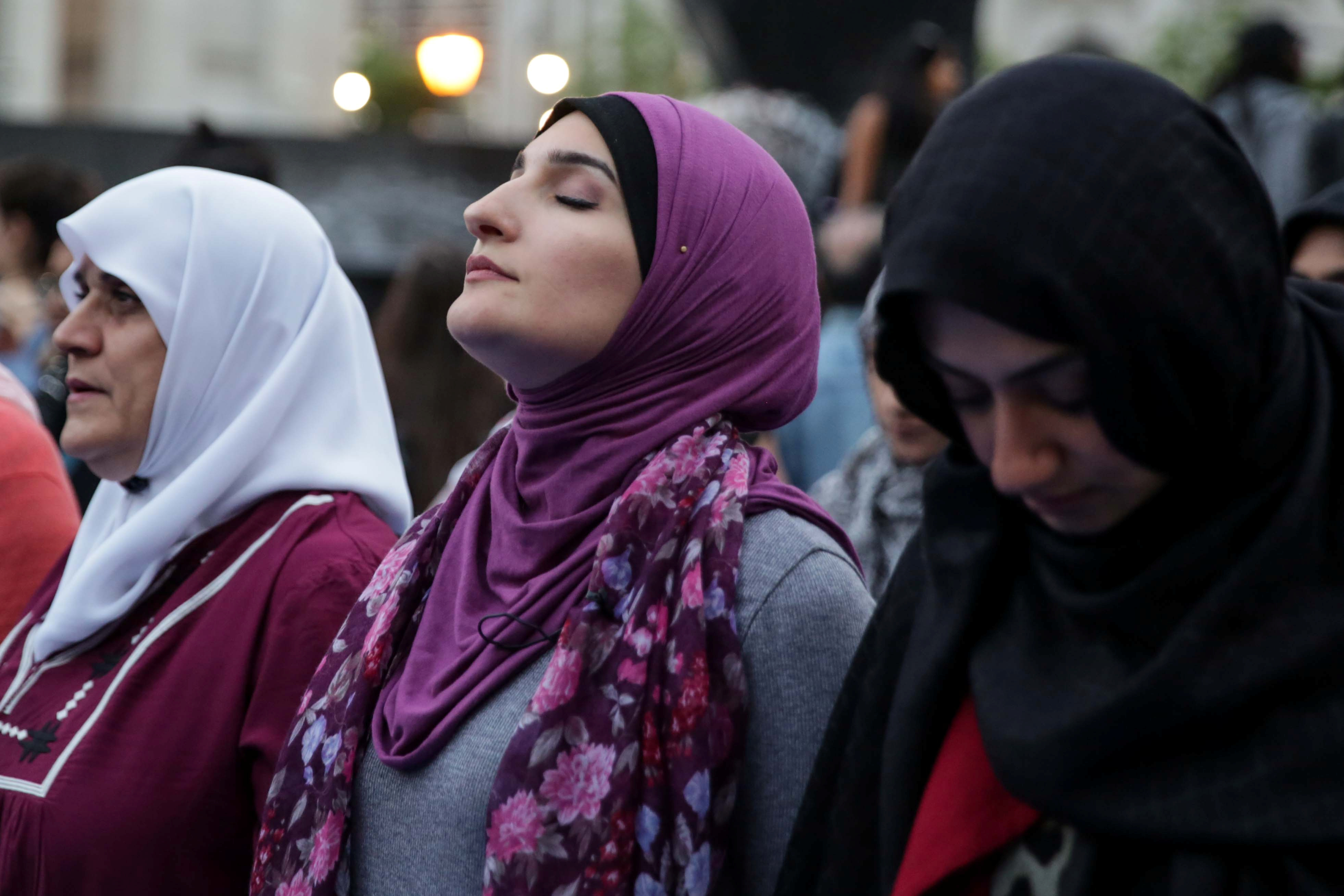 "Muslim American activist Linda Sarsour prepares to perform ""Maghrib"" sunset prayers during an immigration rally and Iftar ""breaking fast"" during the month of Ramadan outside ICE's New York field office at Foley Square in Manhattan, New York, U.S., May 23, 2018. REUTERS/Amr Alfiky - RC18A15B0F00"