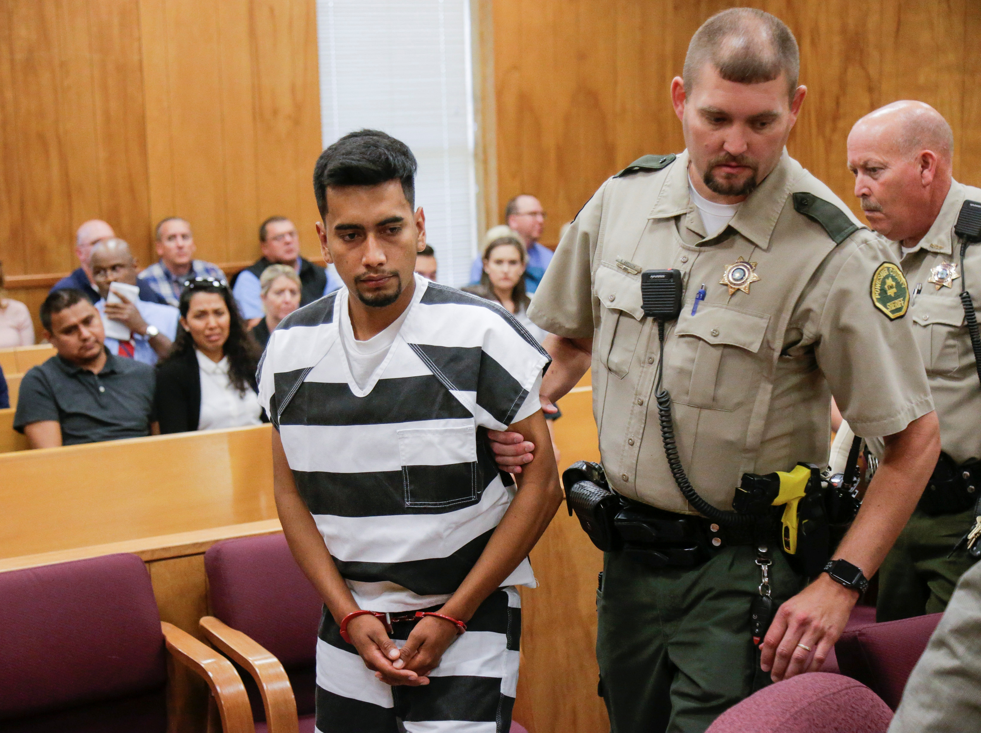 Cristhian Rivera, 24, accused of killing University of Iowa student Mollie Tibbetts, is led from the courtroom after making his initial appearance on a charge of first-degree murder during at the Poweshiek County Courthouse in Montezuma, Iowa, U.S., August 22, 2018. Jim Slosiarek/The Gazette/Pool via REUTERS