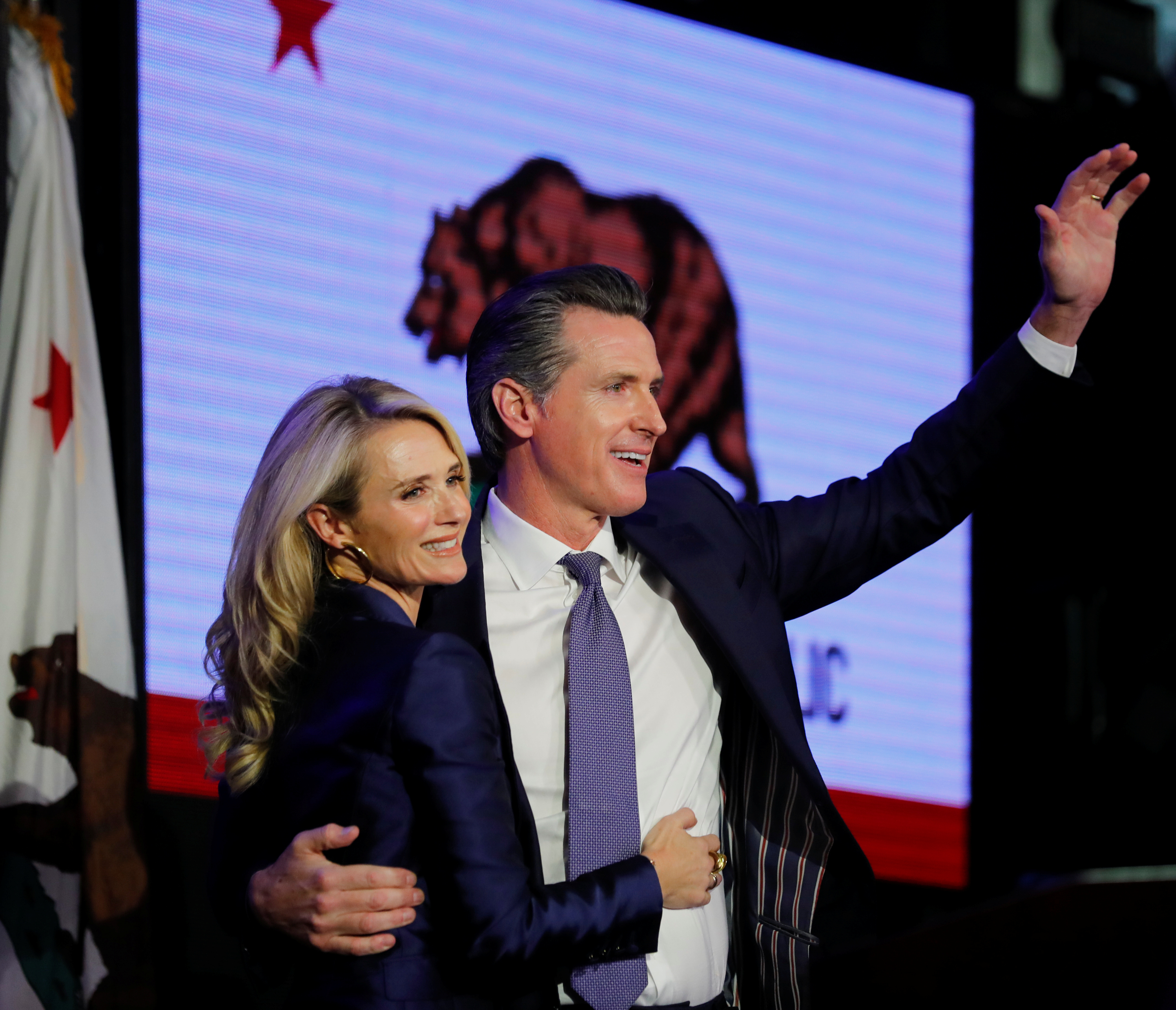 California Democratic gubernatorial candidate Gavin Newsom hugs his wife Jennifer as he celebrates being elected governor of the state during an election night party in Los Angeles, California, U.S. November 6, 2018. REUTERS/Mike Blake - RC1C6303E620