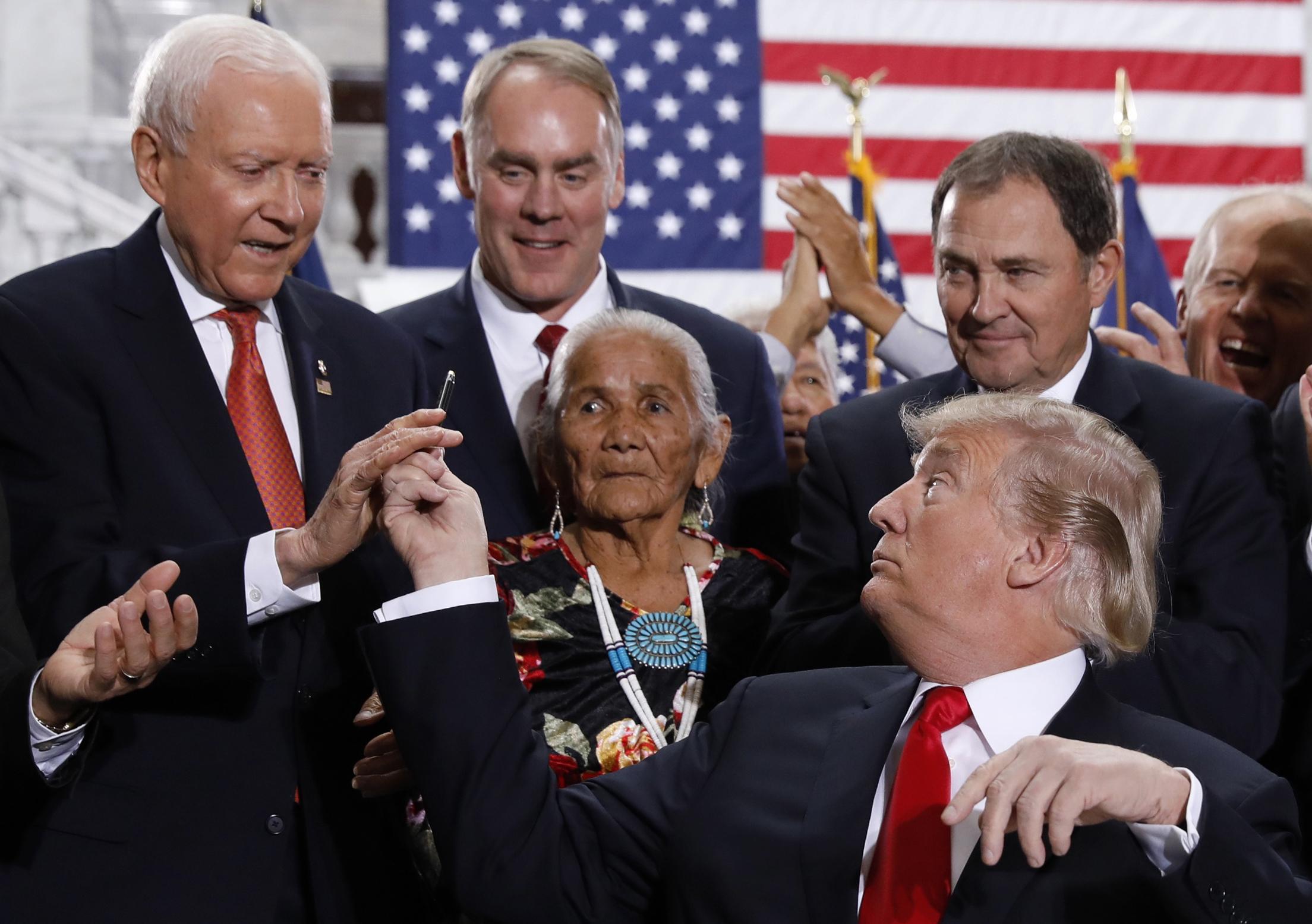 U.S. President Trump hands pend to Hatch after signing Utah monuments executive order at Utah State Capitol in Salt Lake City, Utah