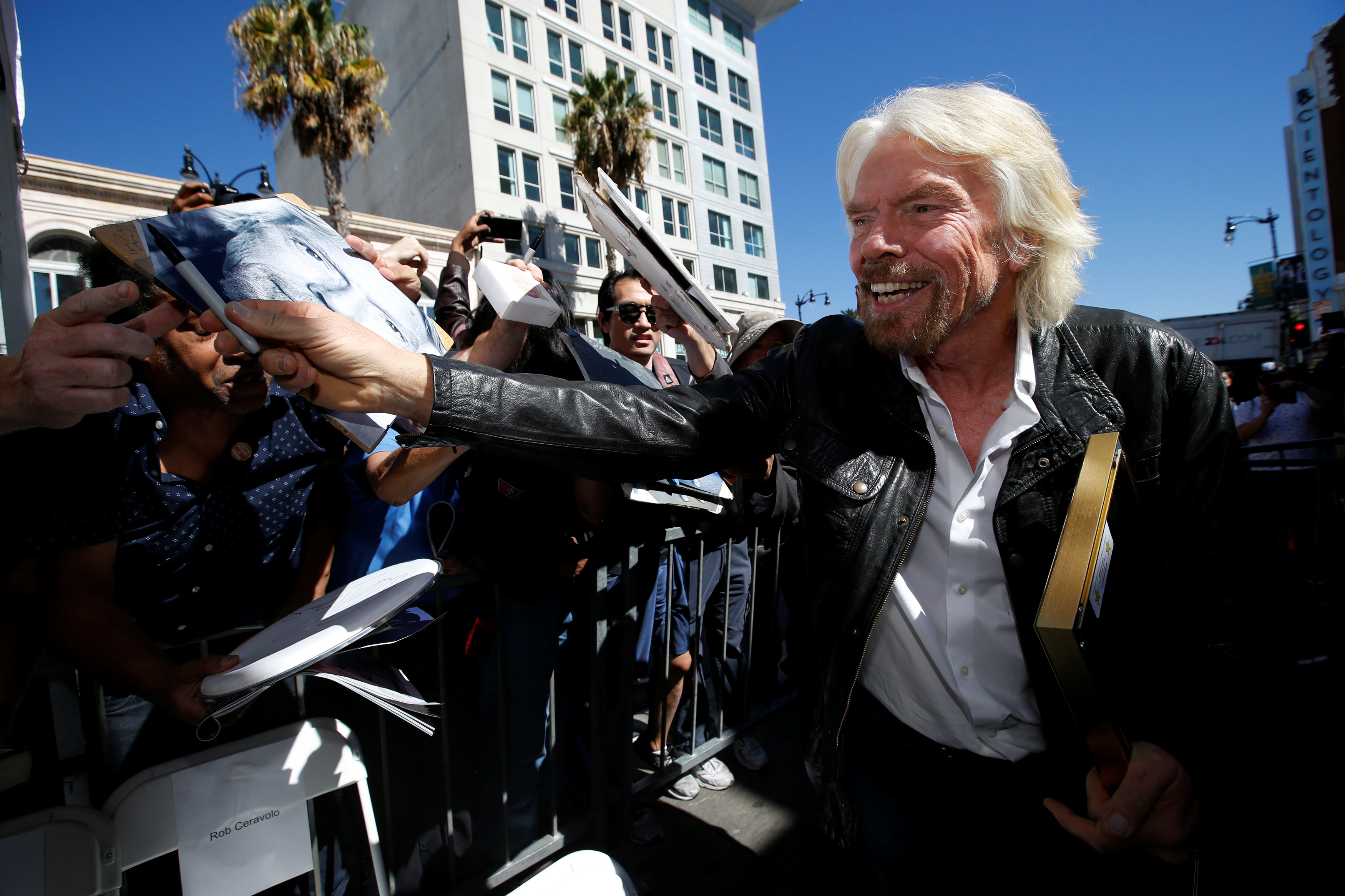 Branson signs autographs after unveiling his star on the Hollywood Walk of Fame in Los Angeles