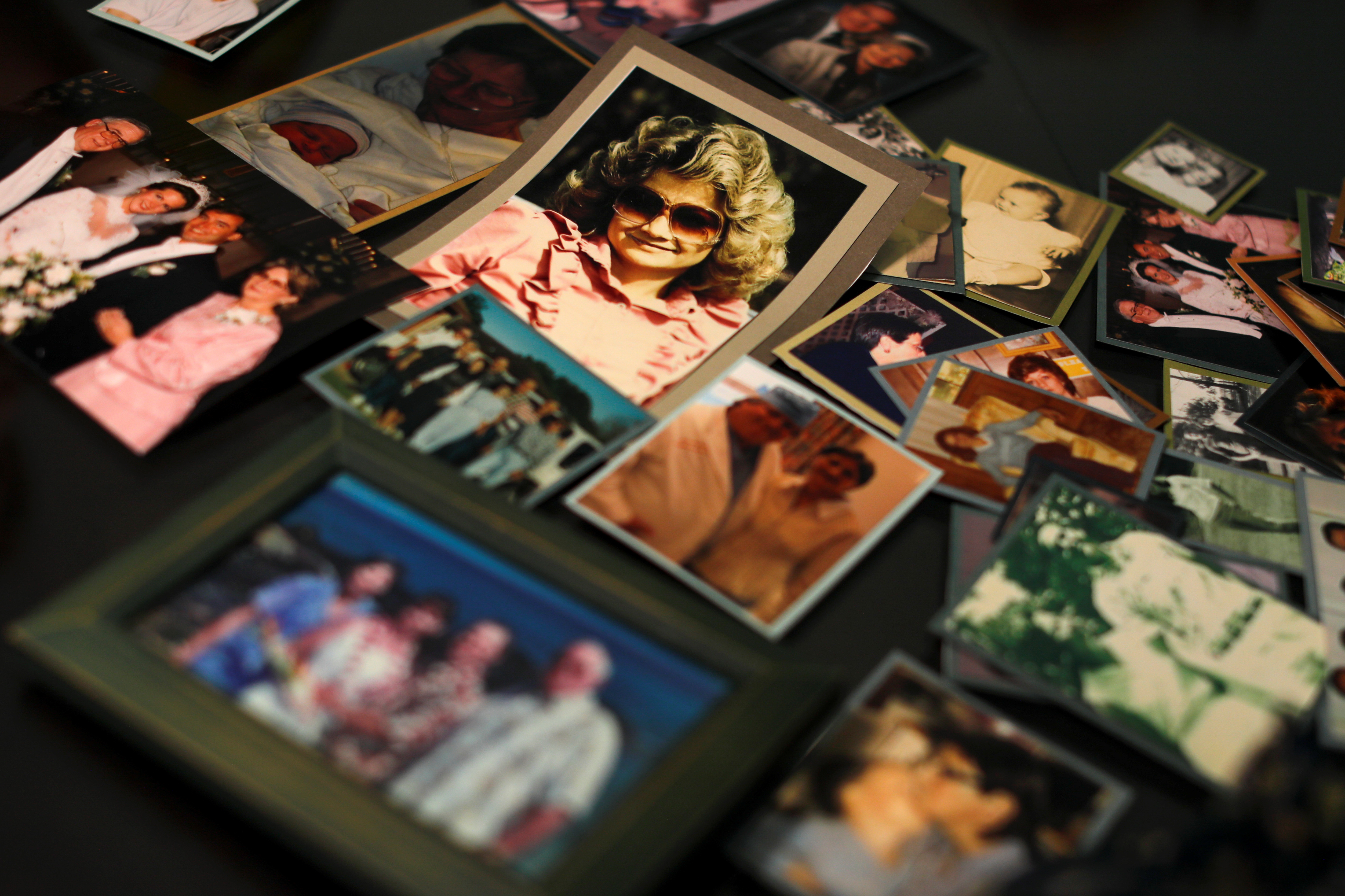 Darlene Coker is shown on a kitchen table full of many personal pictures of her family life in California, U.S. August 15, 2018. Picture taken August 15, 2018. REUTERS/Mike Blake
