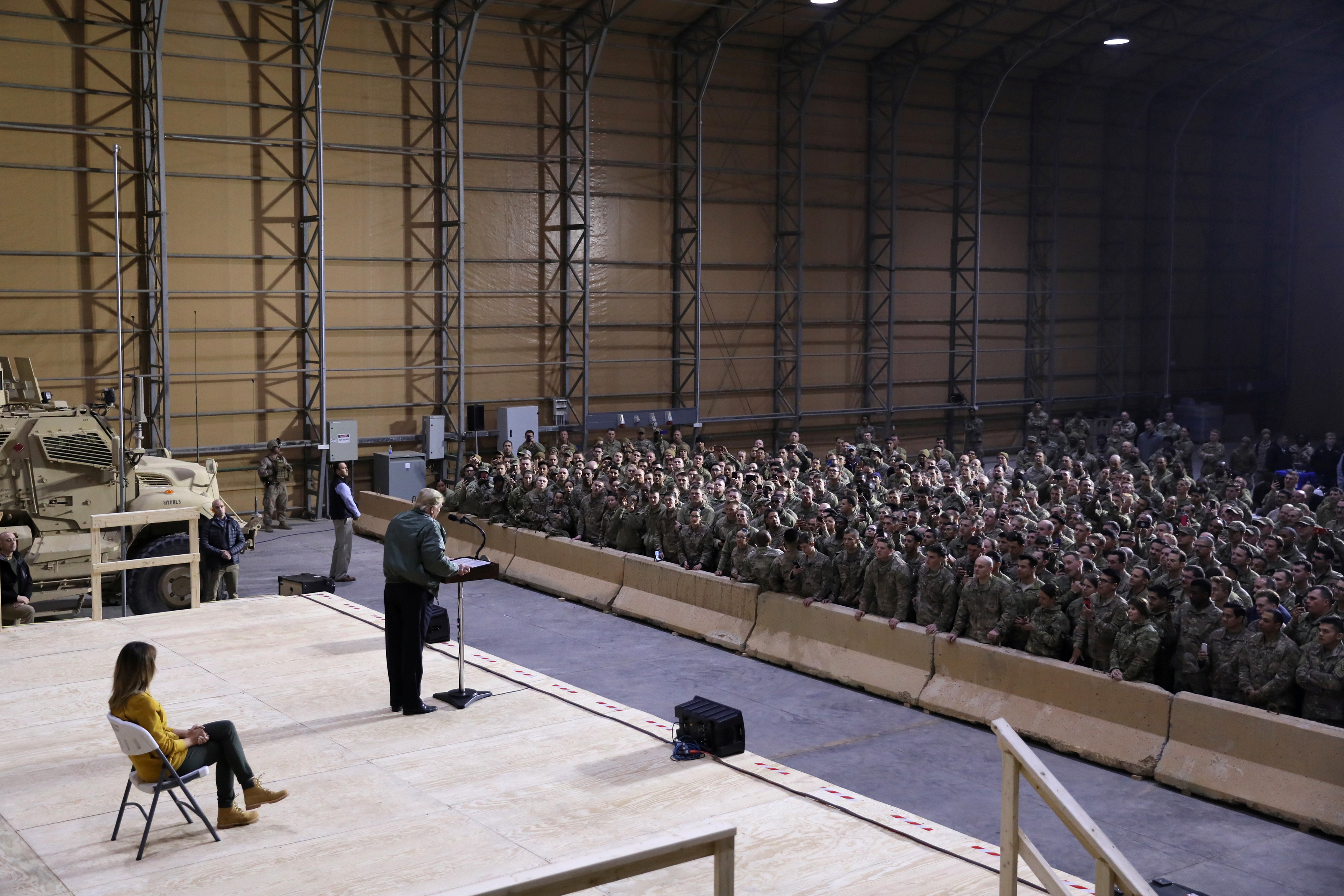 U.S. President Donald Trump delivers remarks to U.S. troops in an unannounced visit to Al Asad Air Base, Iraq December 26, 2018. REUTERS/Jonathan Ernst - RC1801320710