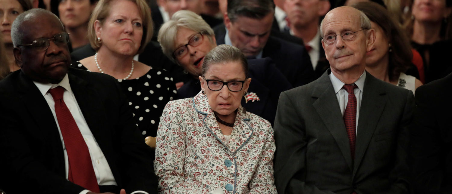 Supreme Court Justices (L-R) Clarence Thomas, Ruth Bader Ginsburg and Stephen Breyer watch from the front row as Brett Kavanaugh takes his ceremonial oath of office. October 8, 2018. REUTERS/Jim Bourg