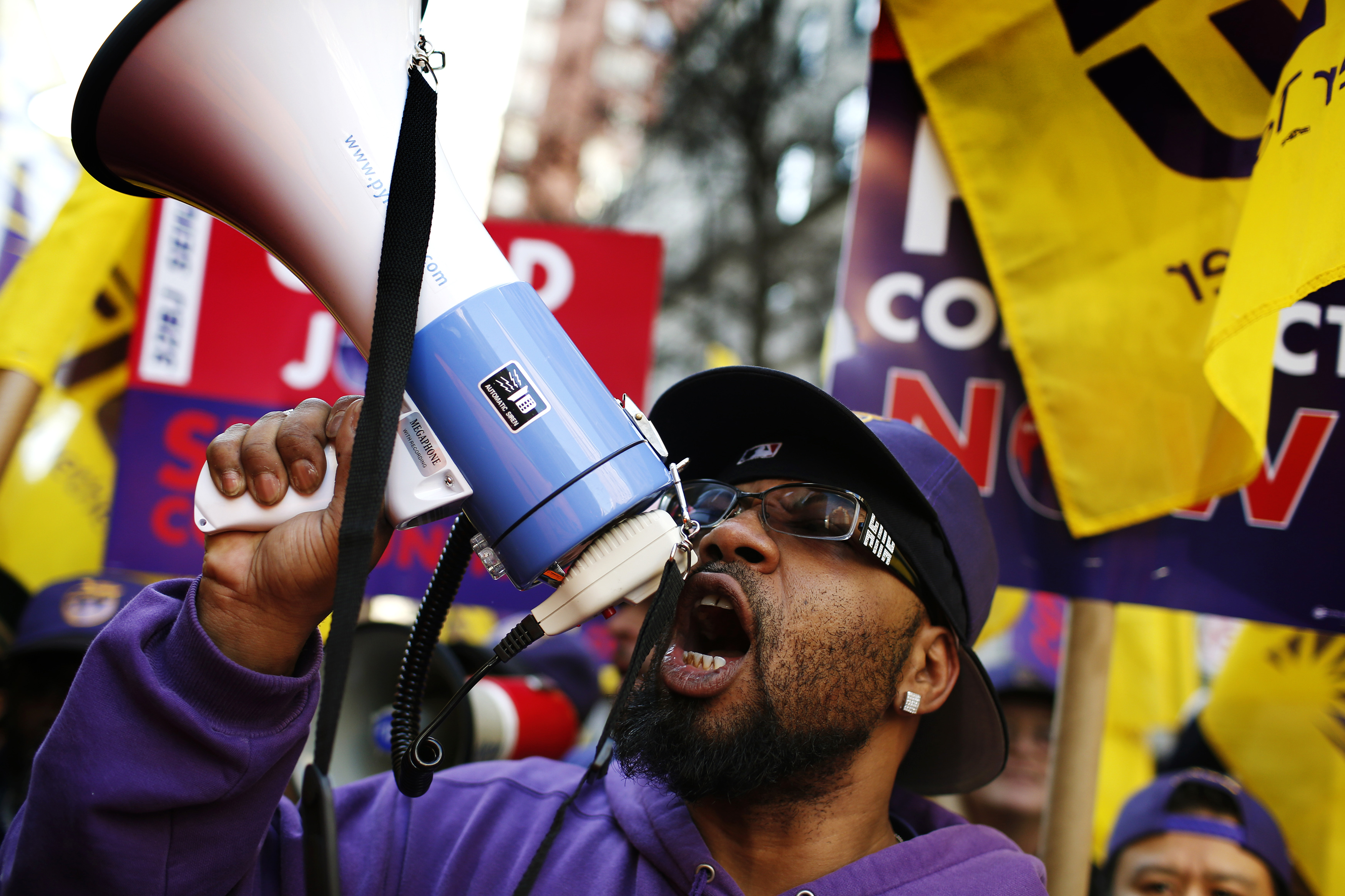 Members of the Service Employees International Union chant slogans during a protest in support of a new contract for apartment building workers in New York City, April 2, 2014. REUTERS/Mike Segar