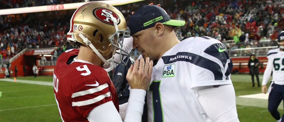 SANTA CLARA, CA - DECEMBER 16: Robbie Gould #9 of the San Francisco 49ers speaks with Sebastian Janikowski #11 of the Seattle Seahawks after the 49ers 26-23 win over the Seahawks at Levi's Stadium on December 16, 2018 in Santa Clara, California. (Photo by Ezra Shaw/Getty Images)