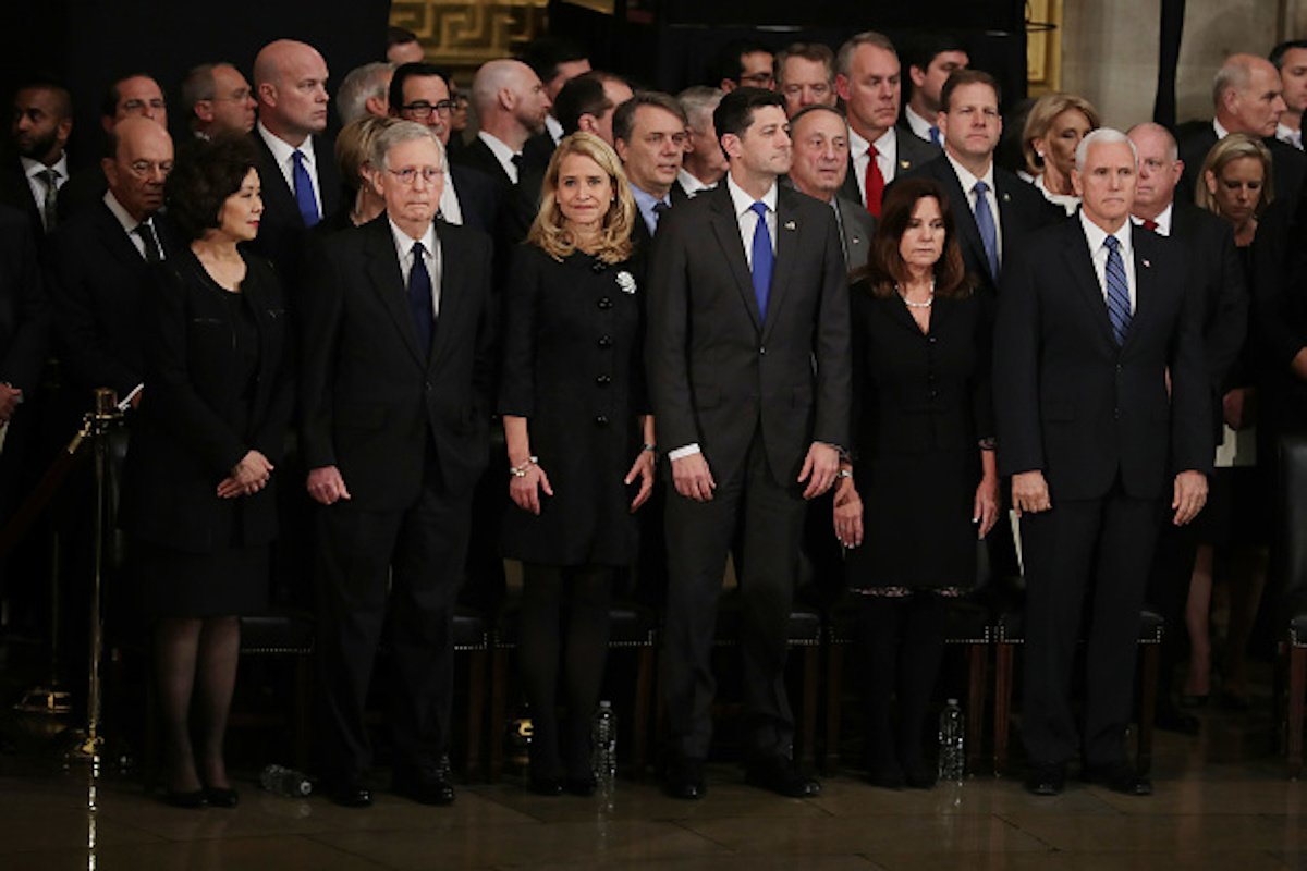 WASHINGTON, DC - DECEMBER 03: (L-R) Transportation Secretary Elaine Chao, Senate Majority Leader Mitch McConnell (R-KY), Janna Ryan, Speaker of the House Paul Ryan (R-WI), Karen Pence and Vice President Mike Pence attend a memorial ceremony for former U.S. President George H.W. Bush in the U.S. Capitol Rotunda December 03, 2018 in Washington, DC. A WWII combat veteran, Bush served as a member of Congress from Texas, ambassador to the United Nations, director of the CIA, vice president and 41st president of the United States. Members of the public can pay their respects as Bush lays in state until Wednesday, when he will be honored during a memorial service at the National Cathedral. (Photo by Chip Somodevilla/Getty Images)