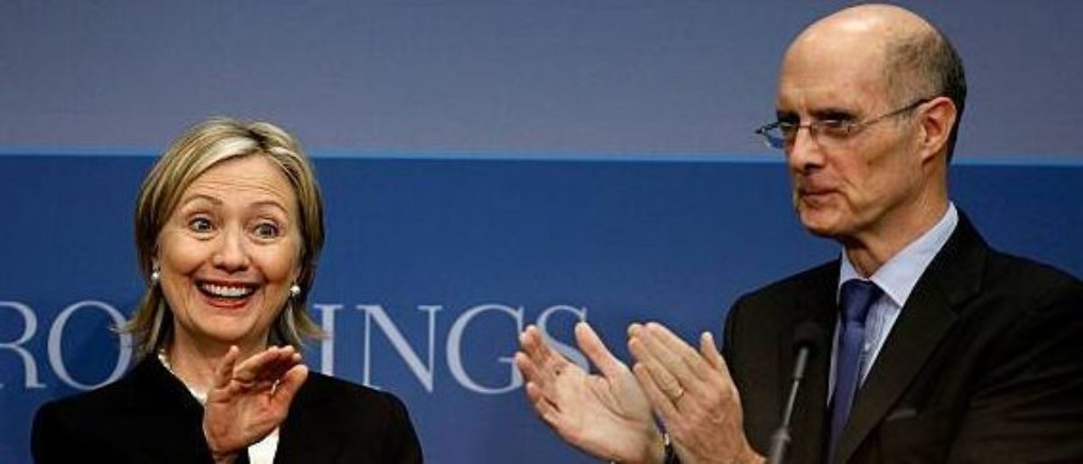 WASHINGTON - MAY 27: U.S. Secretary of State Hillary Clinton (L) is applauded by Brookings Institution President Strobe Talbott before she delivers remarks about the Obama administration's national security strategy at the Brookings Institution May 27, 2010 in Washington, DC. Clinton addressed a variety of security topics, including the prevention of nuclear proliferation, terrorism, the use of military force, development and diplomacy. (Photo by Chip Somodevilla/Getty Images)
