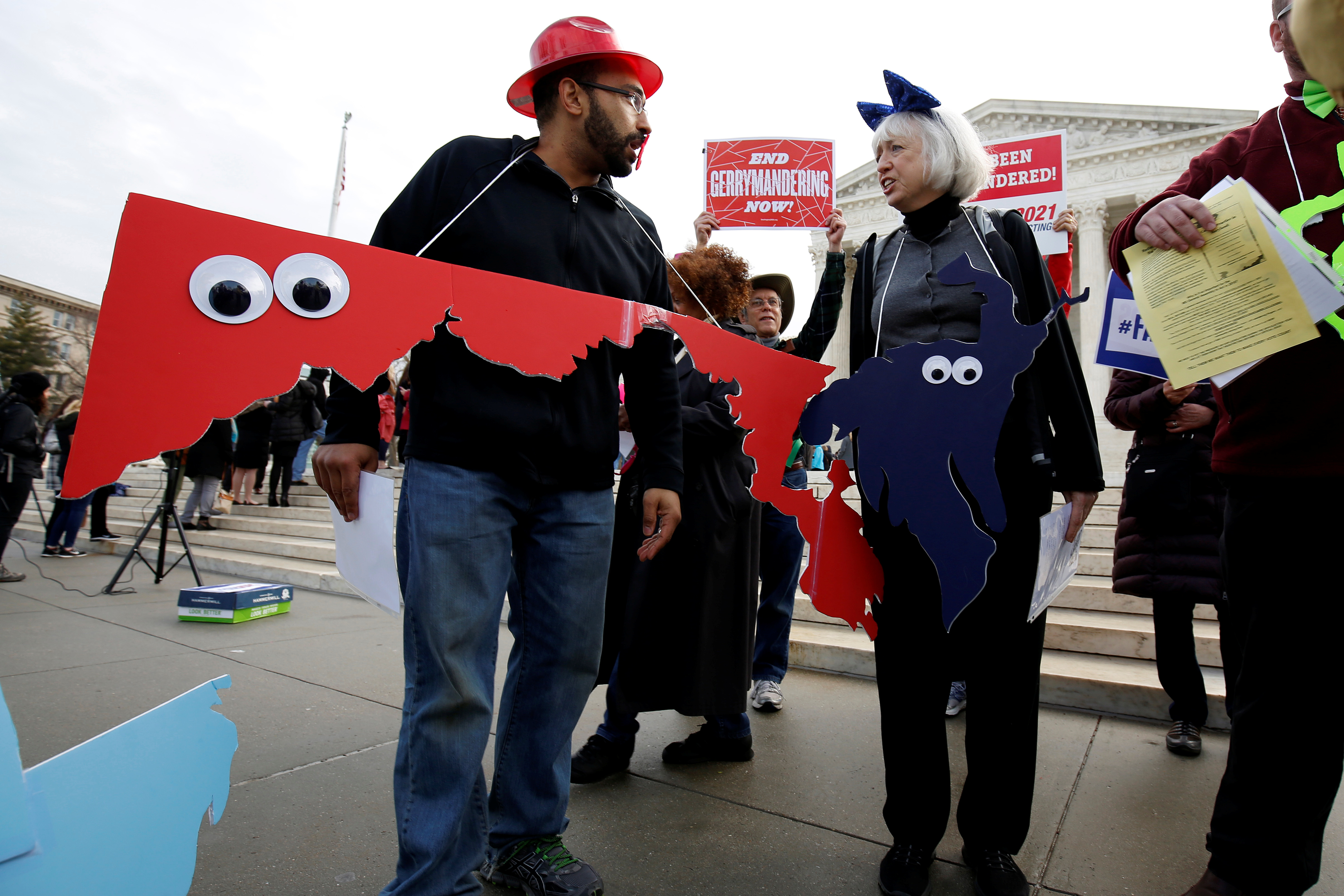 Demonstrators rally with cut-outs of congressional districts in front of the Supreme Court before oral arguments on Benisek v. Lamone, a redistricting case on whether Democratic lawmakers in Maryland unlawfully drew a congressional district in a way that would prevent a Republican candidate from winning. REUTERS/Joshua Roberts