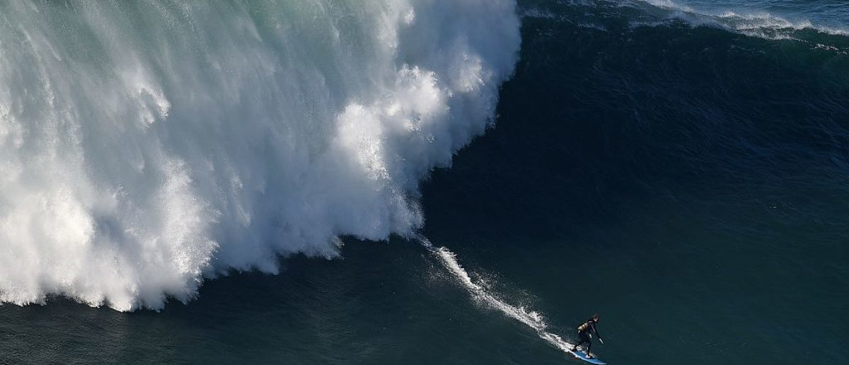 British big wave surfer Tom Butler drops a wave at Nazare's North Beach on November 29, 2014. AFP PHOTO/ FRANCISCO LEONG (Photo credit should read FRANCISCO LEONG/AFP/Getty Images)