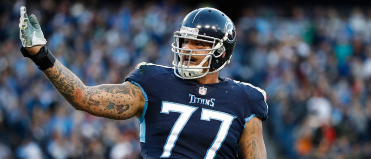 NASHVILLE, TN - DECEMBER 2: Taylor Lewan #77 of the Tennessee Titans jesters to the crowd after the Tennessee Titans scored a touchdown during the second quarter at Nissan Stadium on December 2, 2018 in Nashville, Tennessee. (Photo by Wesley Hitt/Getty Images)