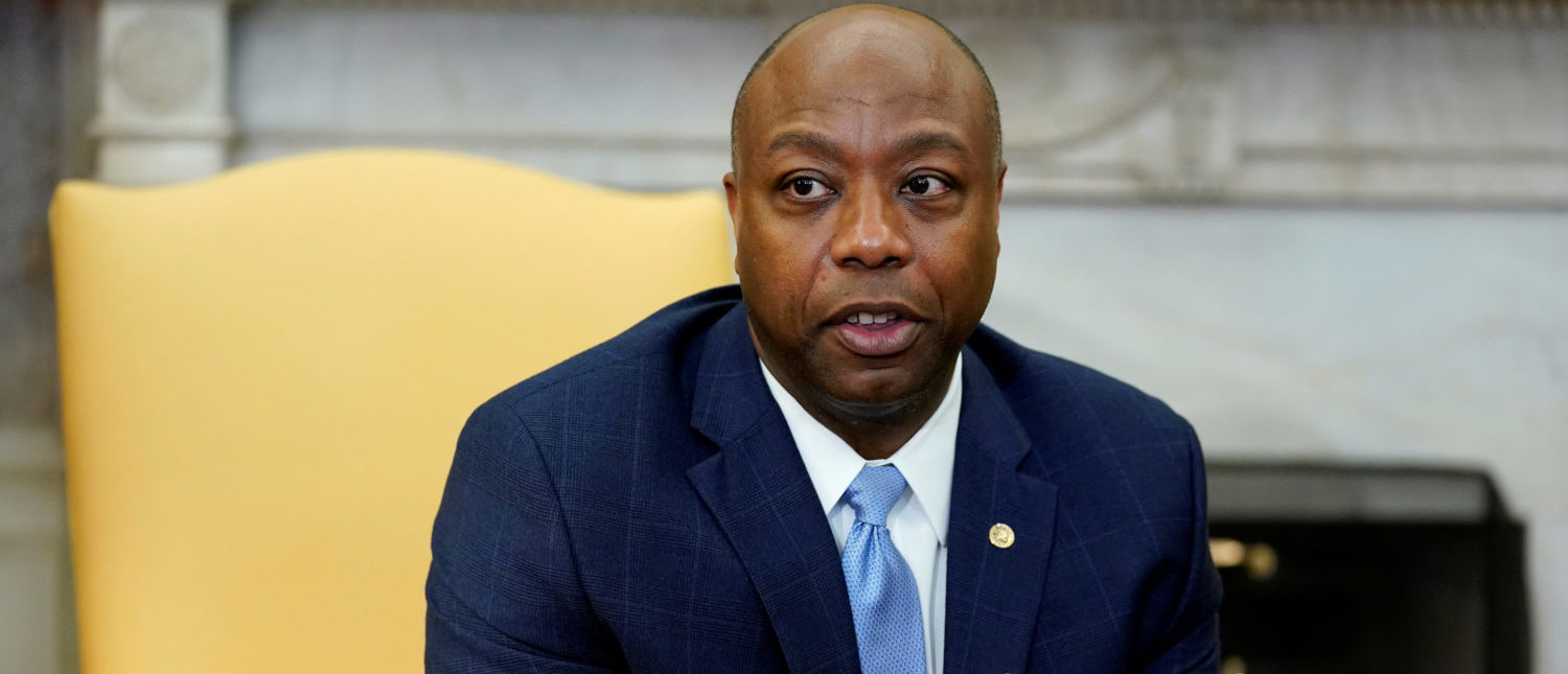 Senator Tim Scott (R-SC) speaks as U.S. President Donald Trump participates in a working session regarding the Opportunity Zones provided by tax reform in the Oval Office of the White House. REUTERS/Joshua Roberts